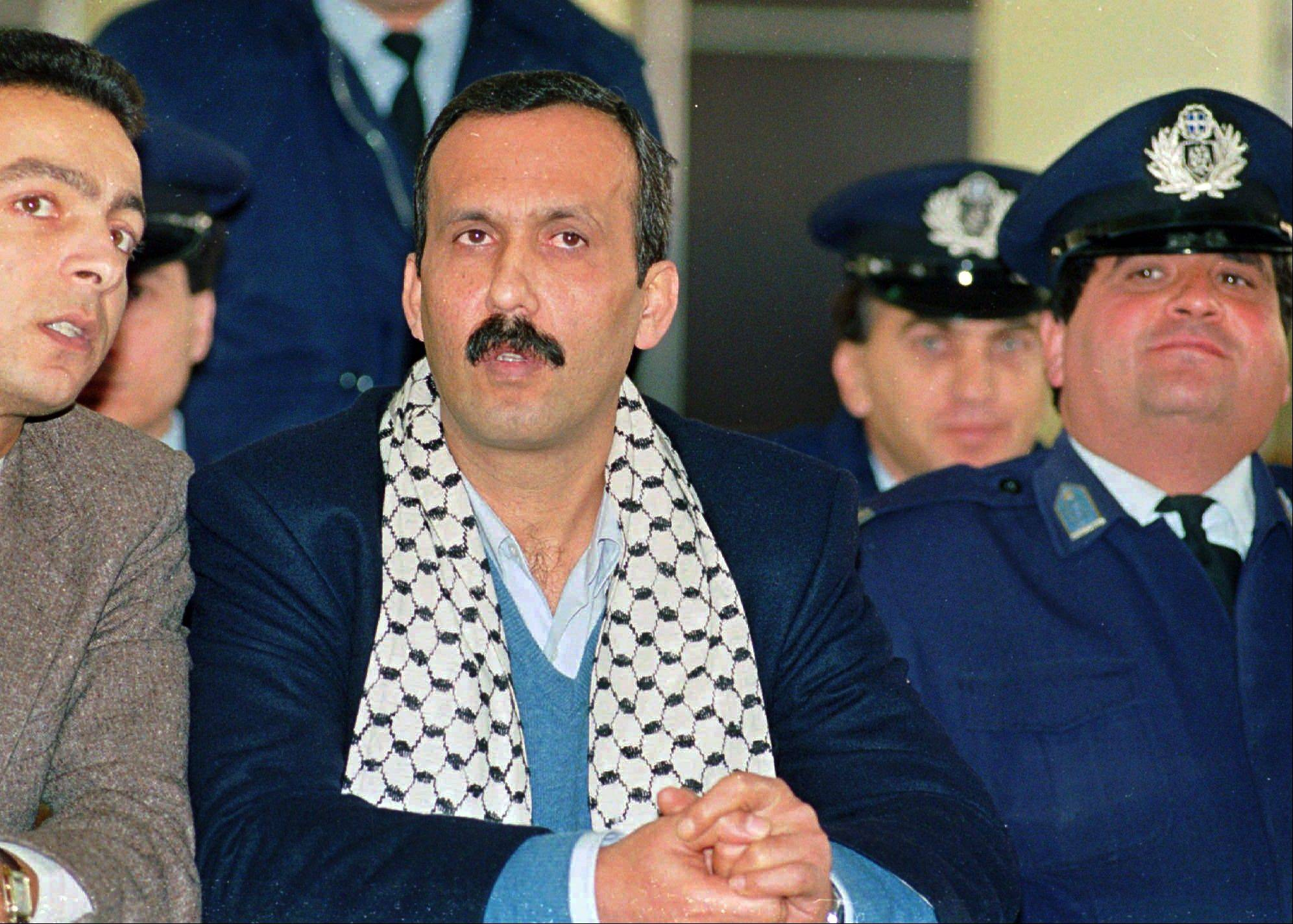 Associated Press/December 12, 1991 Mohammed Rashed, center, convicted of the 1982 PanAm jetliner bombing, listens to his unidentified PLO interpreter, left, during his appeals court hearing in Athens, Greece.