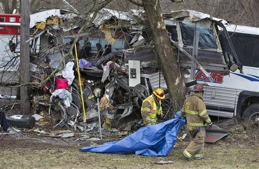 A tour bus carrying a college's women's lacrosse team to a game went off the Pennsylvania Turnpike on Saturday and crashed into a tree, killing a pregnant coach and the driver and sending others to hospitals, authorities said.
