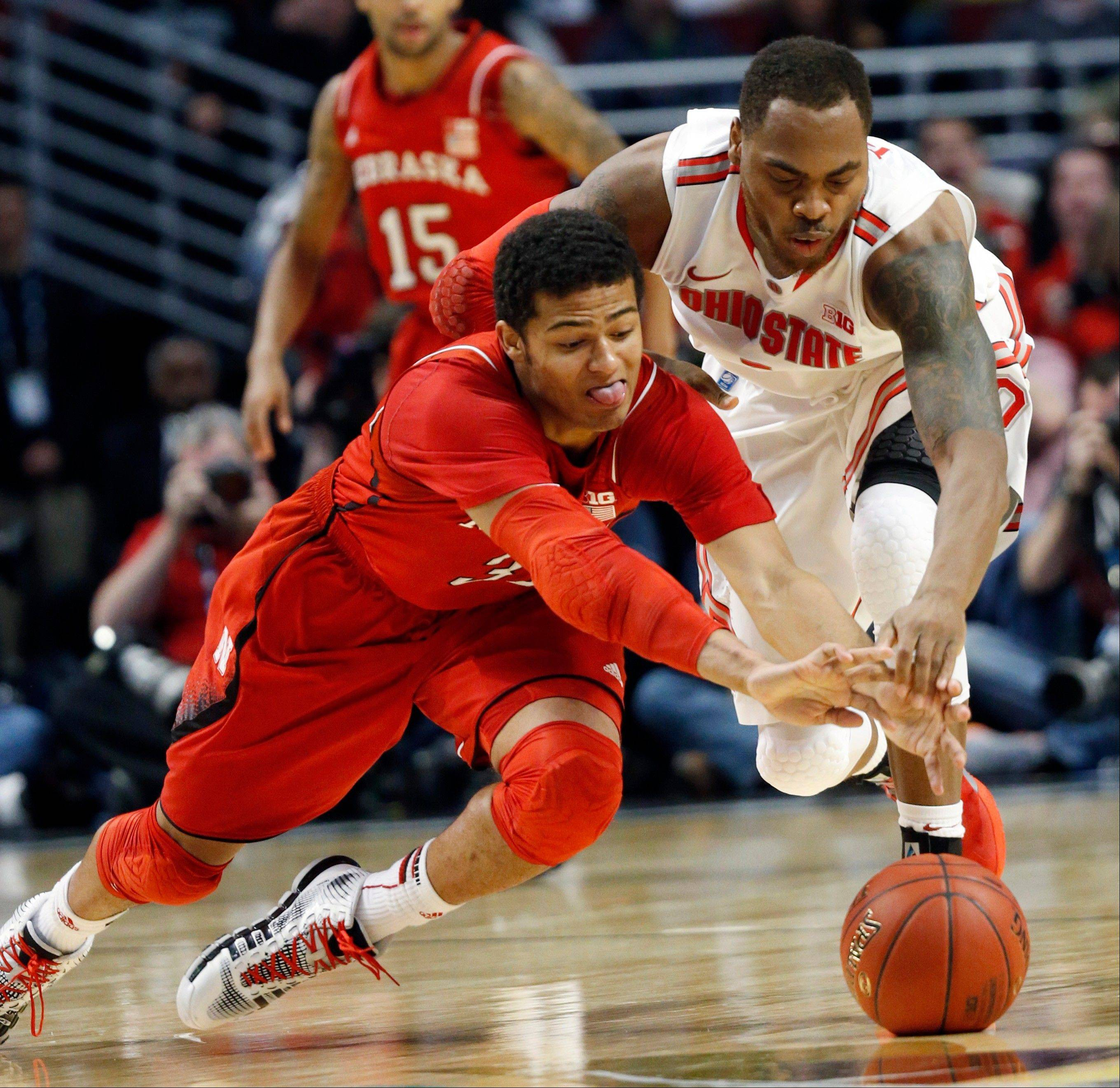 Nebraska's Shavon Shields and Ohio State's Deshaun Thomas battle for a loose ball during the second half of an NCAA college basketball game at the Big Ten tournament Friday, March 15, 2013, in Chicago. (AP Photo/Charles Rex Arbogast)