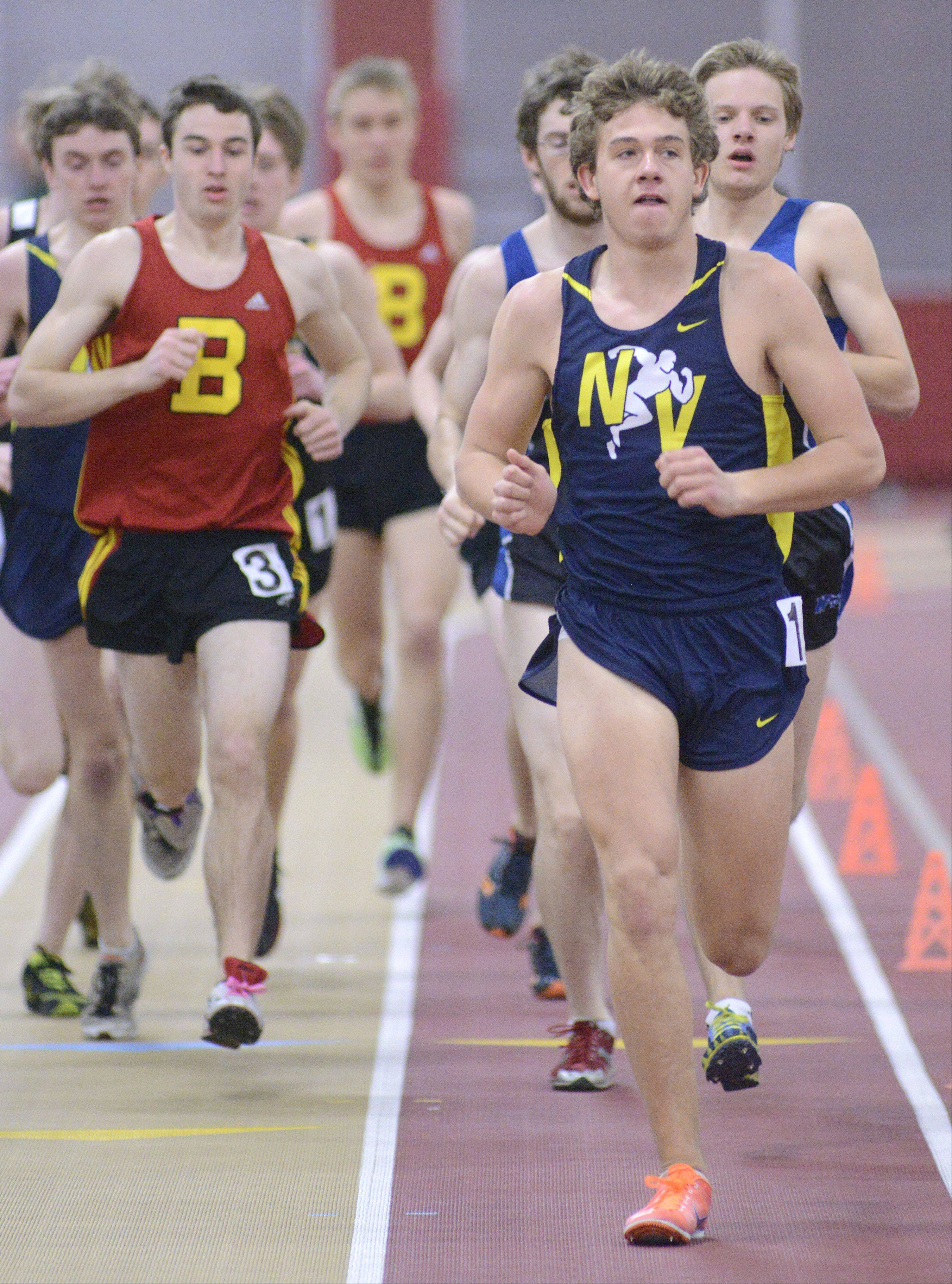 Neuqua Valley's Nick Bushelle leads the 3200 meter run at the Upstate Eight Conference in Batavia on Saturday, March 16.