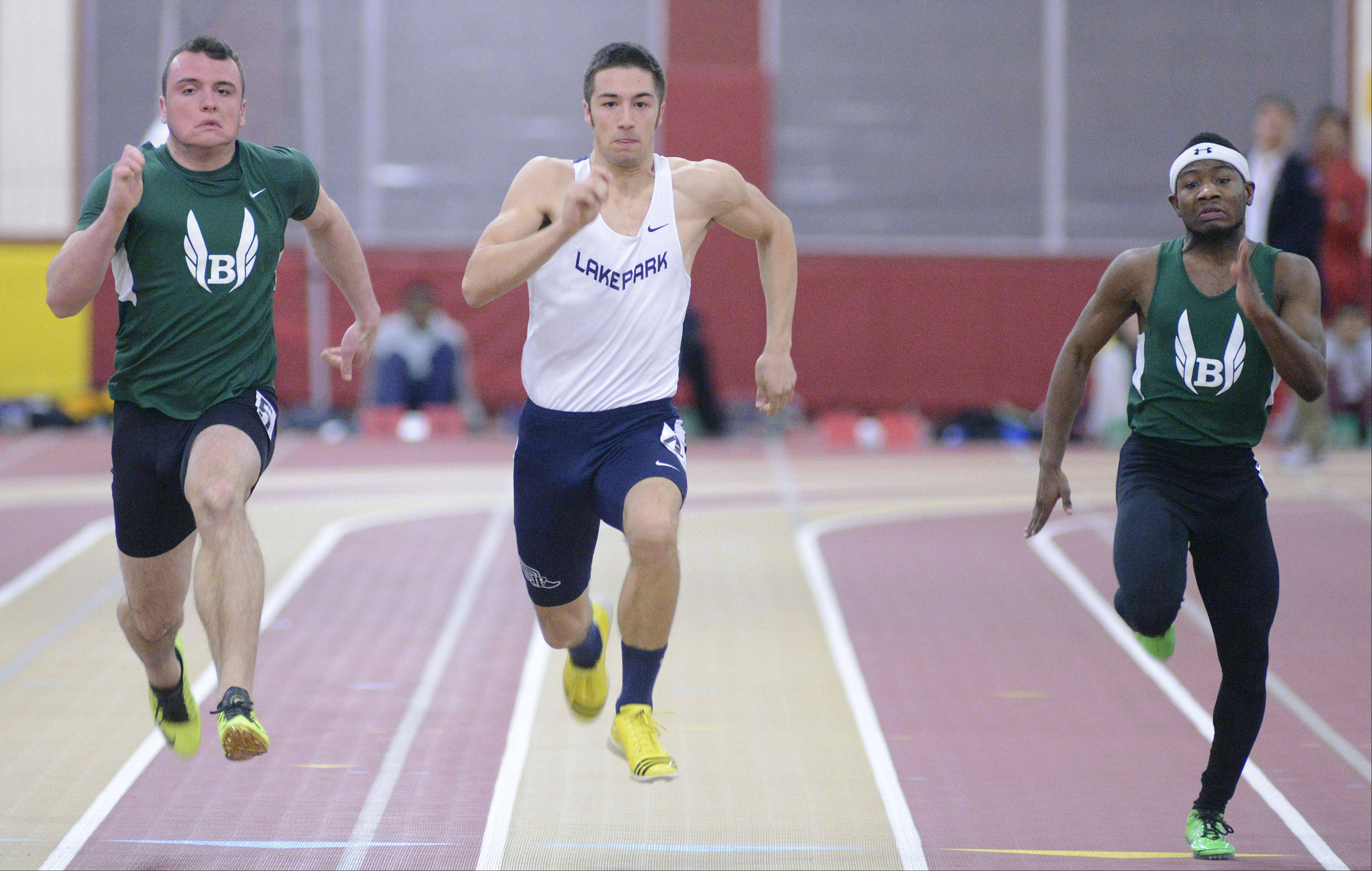 Bartlett's Hurshel Ross, Lake Park's Scott Filip and Bartlett's Aaron Everson compete in the third heat of the 55-meter dash prelims at the Upstate Eight Conference indoor meet at Batavia on Saturday.