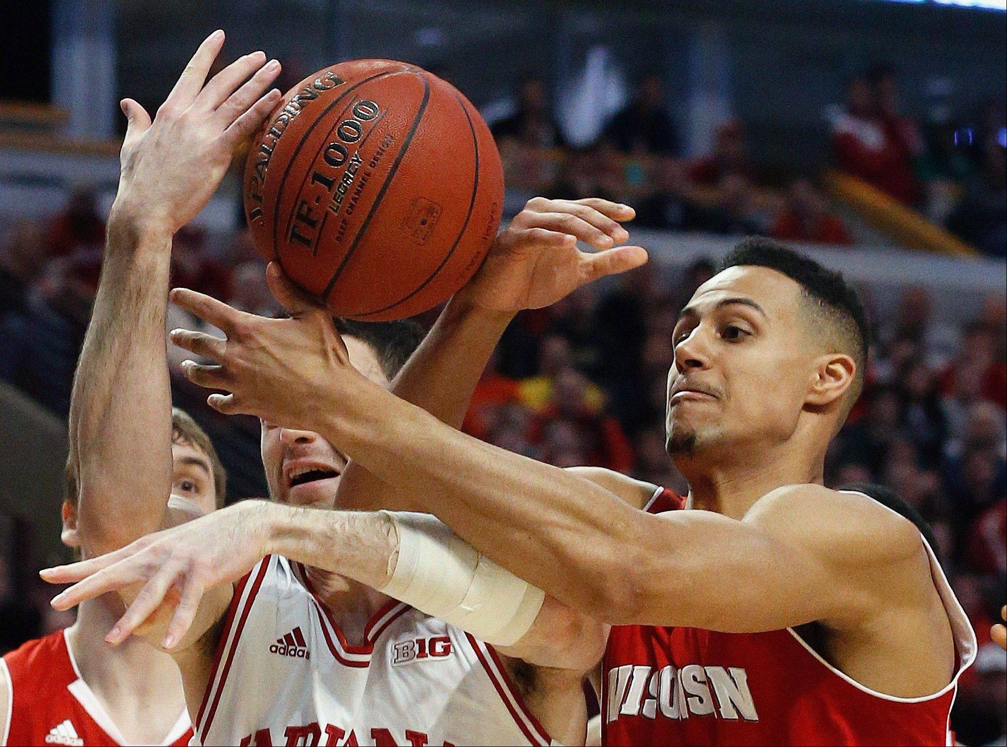 Indiana's Will Sheehey, left, and Wisconsin's Ryan Evans battle for a loose ball during the first half of an NCAA college basketball game in the semifinals of the Big Ten tournament Saturday, March 16, 2013, in Chicago. (AP Photo/Charles Rex Arbogast)