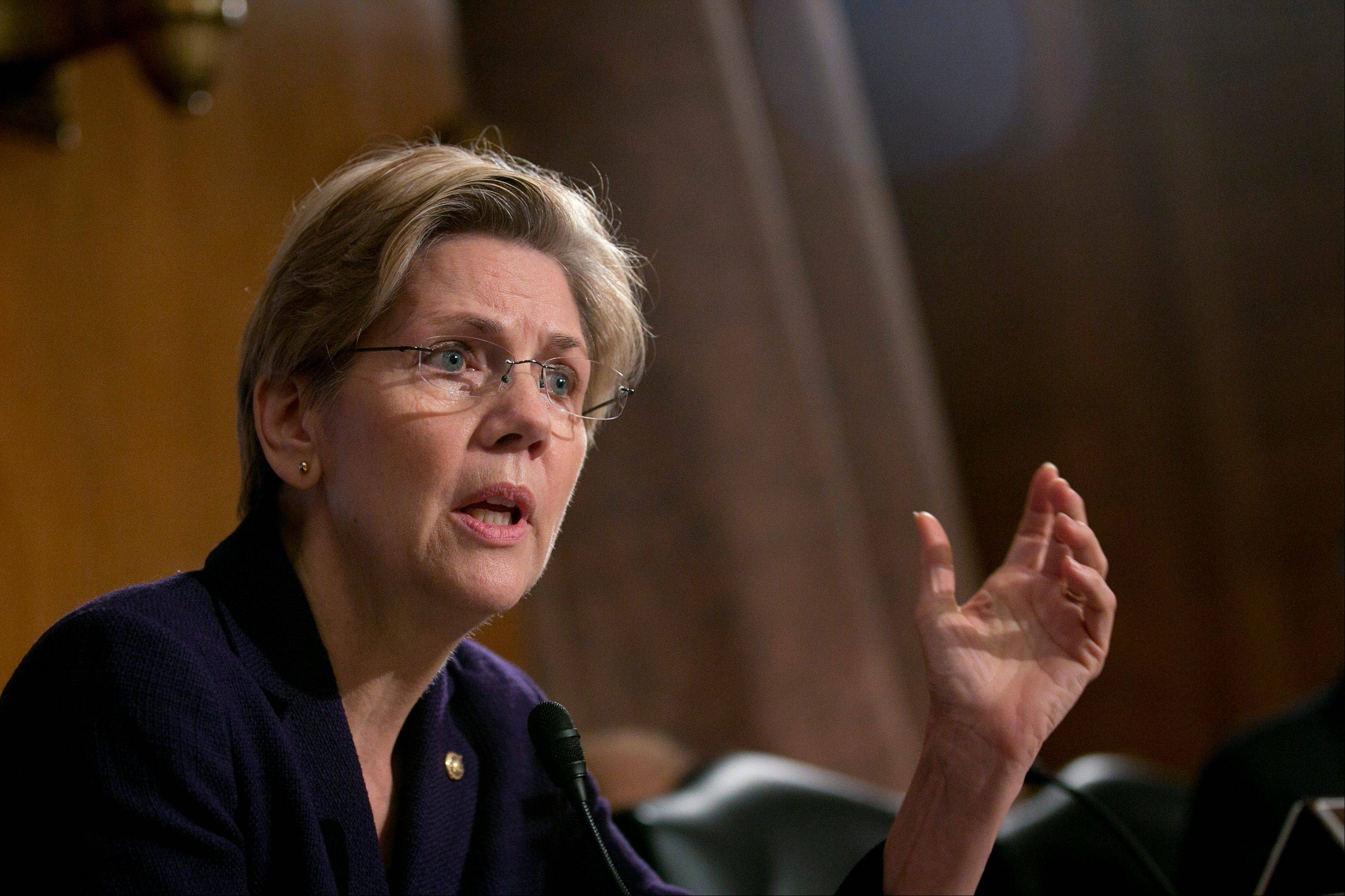 Senator Elizabeth Warren, a Democrat from Massachusetts, questions witnesses during a Senate Banking Committee hearing in Washington last March 7. Regulators are weighing changes to make it easier to eject bankers who knowingly skirt money-laundering rules.