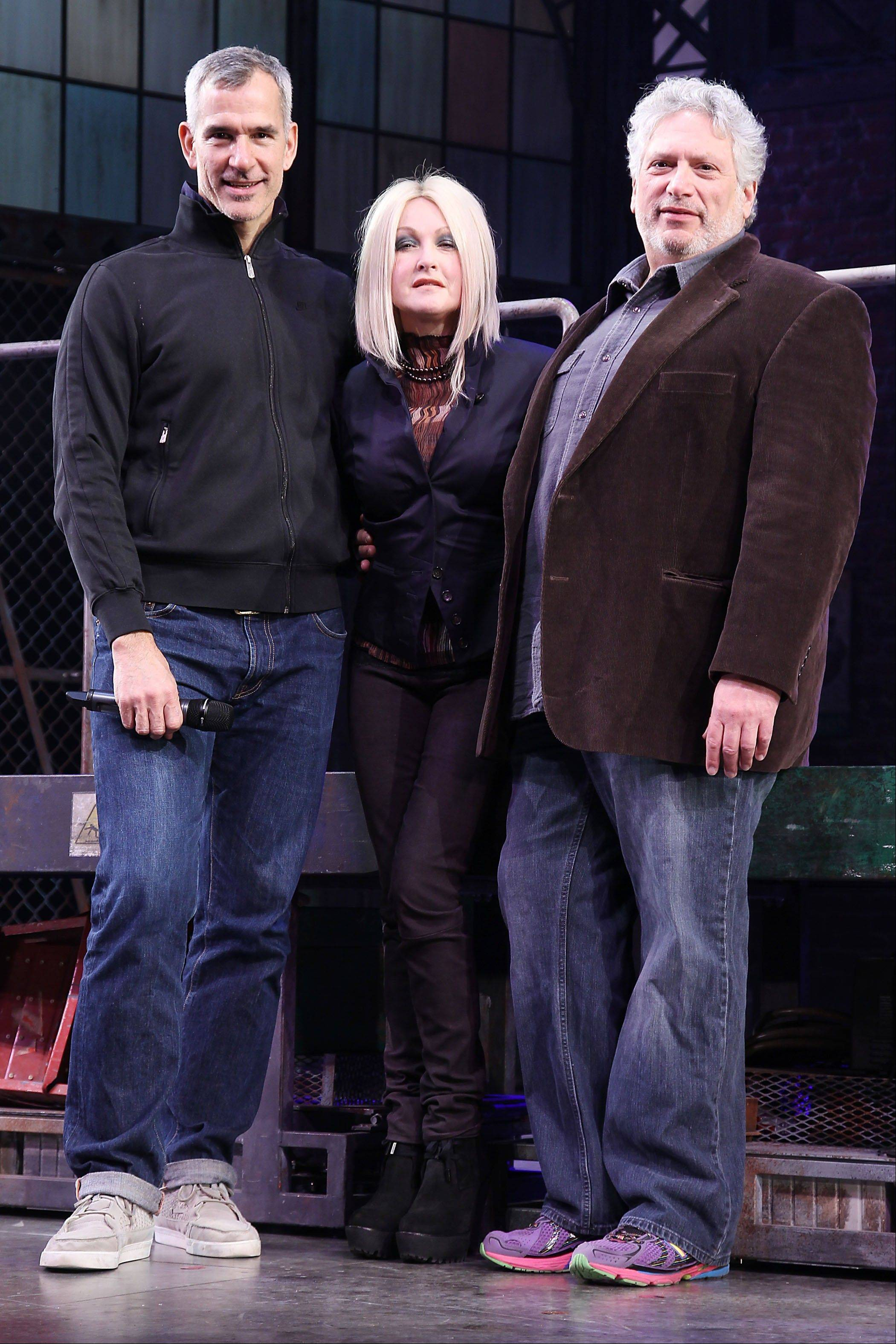 "From left, choreographer Jerry Mitchell, Cyndi Lauper and Harvey Fierstein at the open house for the Upcoming Musical ""Kinky Boots,"" featuring Music by Cyndi Lauper, at the Al Hirshfeld Theatre in New York."