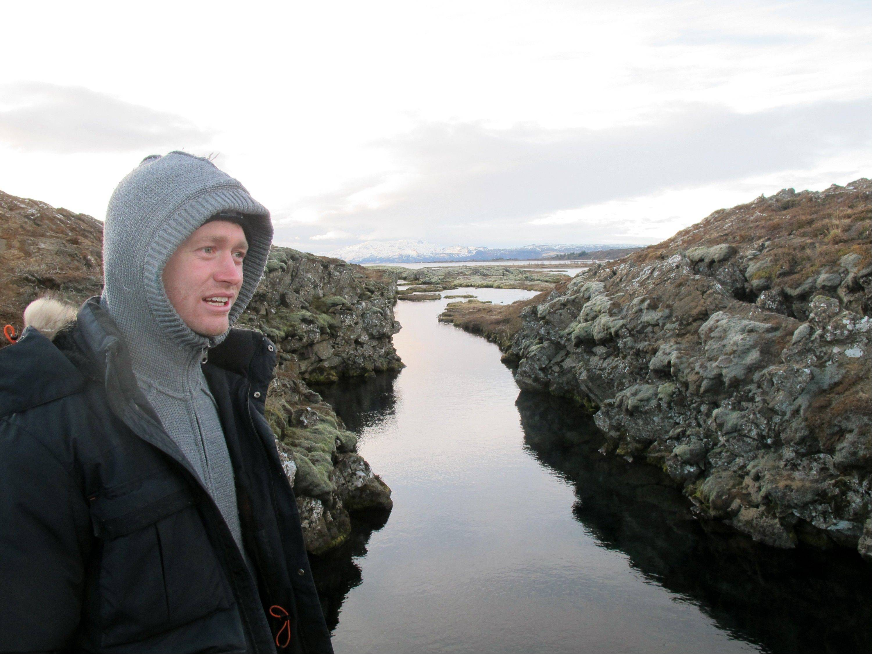 Louis Kotze of DIVE.IS gives instructions to snorkelers at Iceland's Silfra rift, which is fed by glacial water.