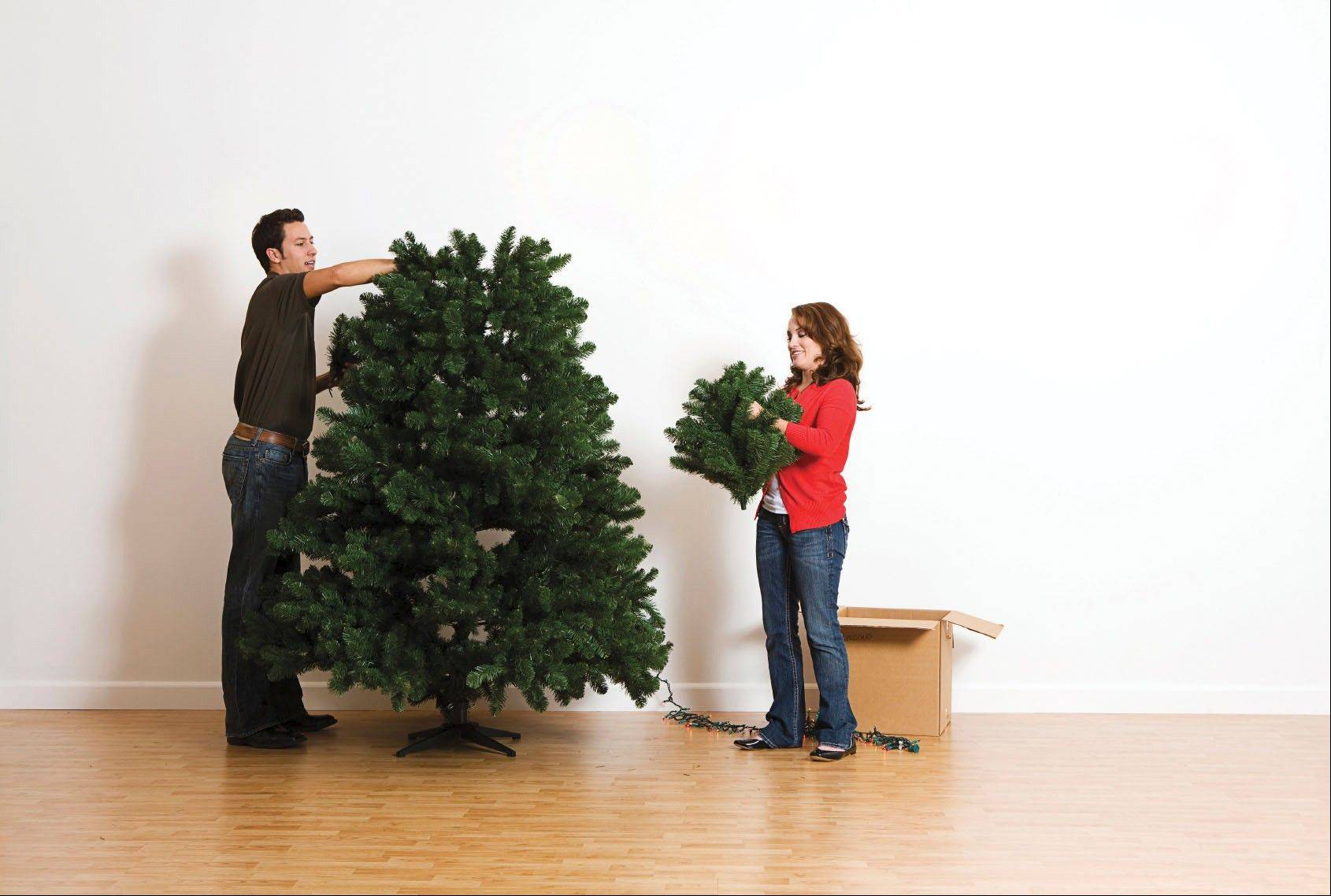 Holiday help: Wrap strands of lights around cardboard to keep them untangled, and look for specially designed containers for oddly-shaped decorations like artificial trees.