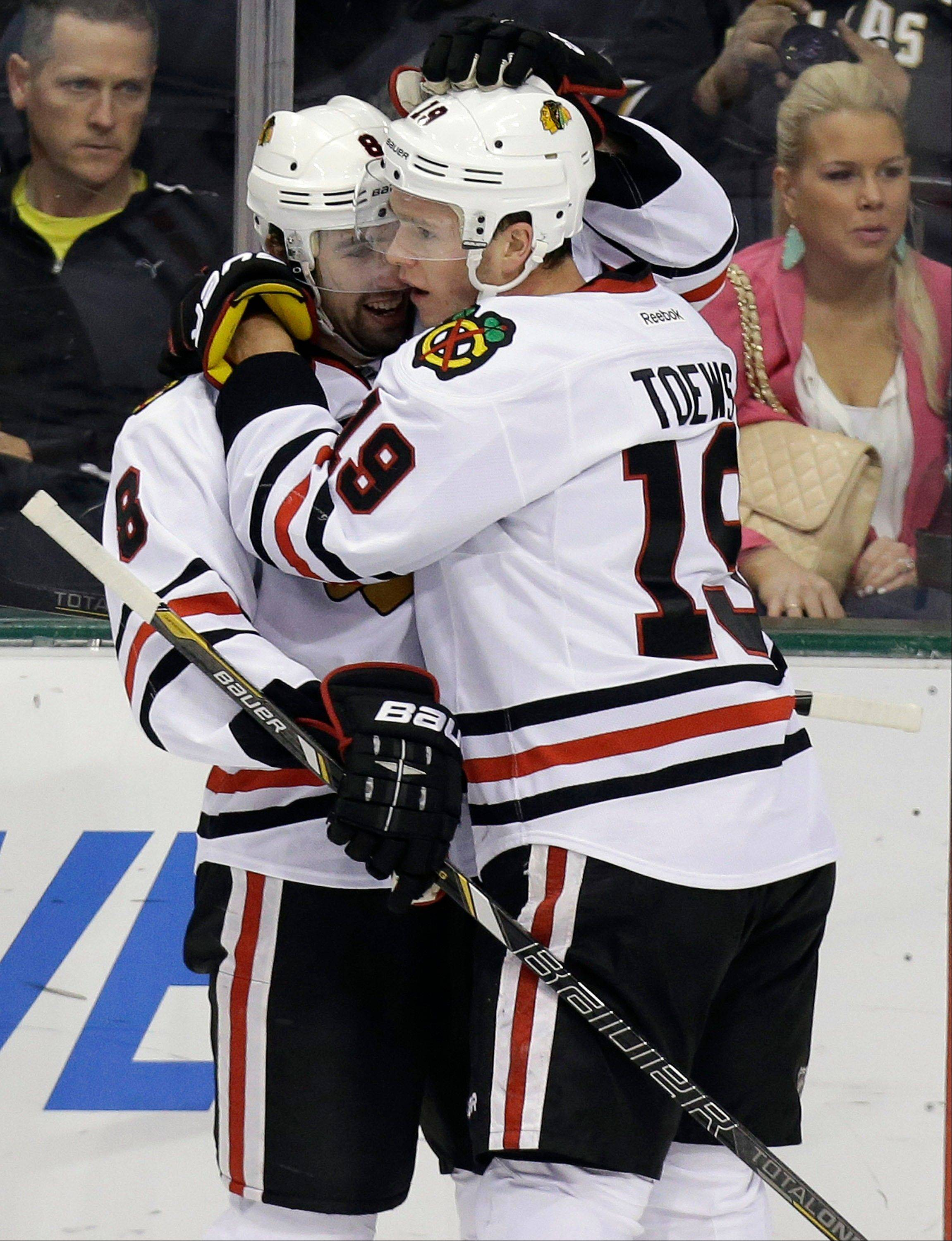 Chicago Blackhawks center Jonathan Toews (19) celebrates his goal with teammate Nick Leddy (8) during the Hawks' win against the Stars Saturday night in Dallas.