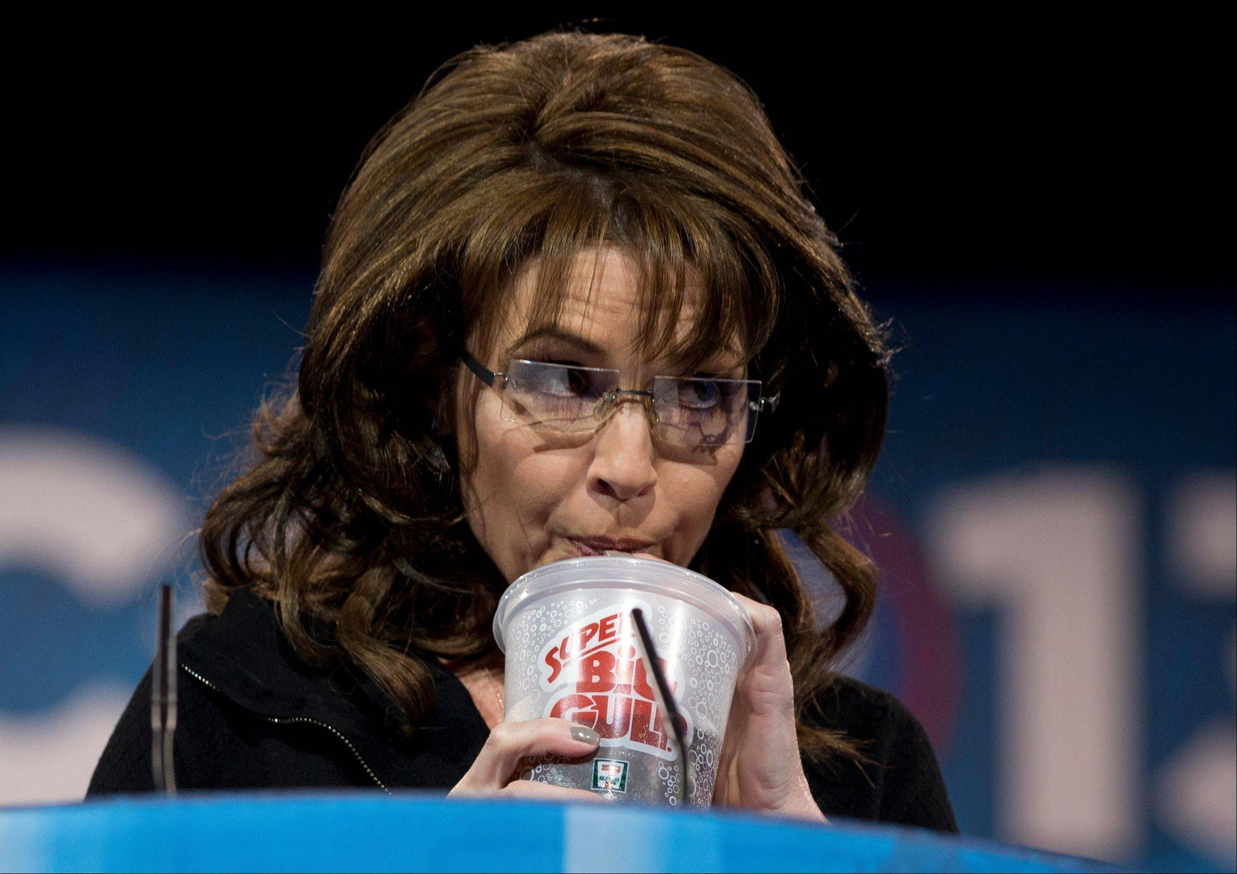Former Alaska Gov. Sarah Palin drinks from a 7-Eleven Super Big Gulp on stage while speaking Saturday at the 40th annual Conservative Political Action Conference in National Harbor, Md. Earlier in the week a New York judge struck down a ban proposed by New York Mayor Michael Bloomberg to end the sale of sugared sodas larger than 16 oz.