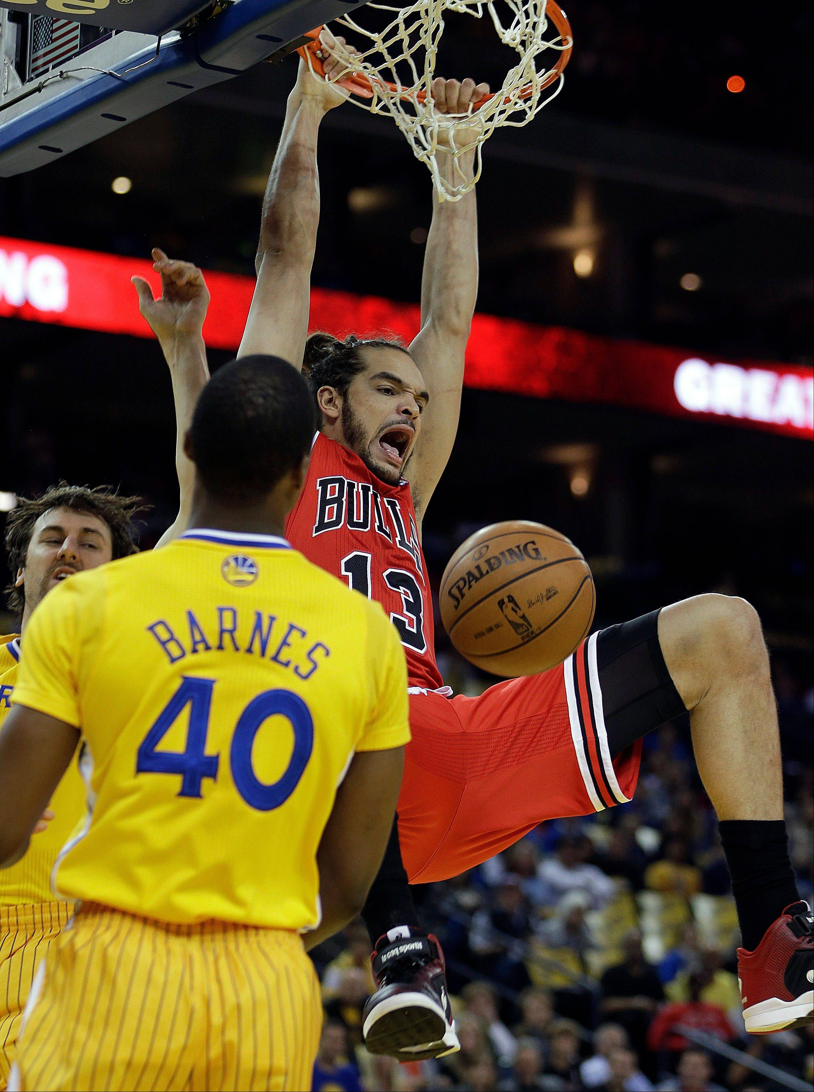 Chicago Bulls' Joakim Noah scores over Golden State Warriors' Harrison Barnes Friday. Under a New Jersey proposal bettors would put a one-day team together and compete for a pool of cash.