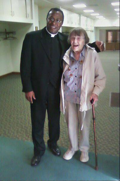 Sister Johanna Murphy, on the eve of turning 100, visits with the Rev. Martens Emeh, pastor of St. Peter church in Geneva.