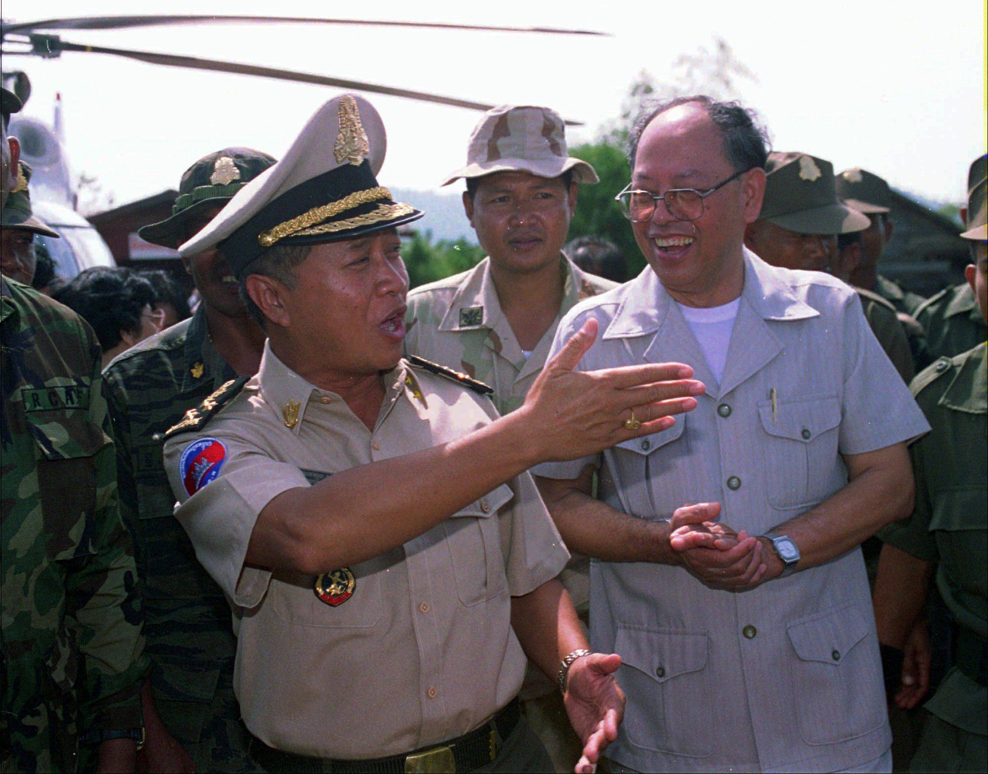 First Prime Minister Prince Norodom Ranariddh, left, chats with dissident Khmer Rouge leader Ieng Sary, right, upon his arrival at Malai, Cambodia.