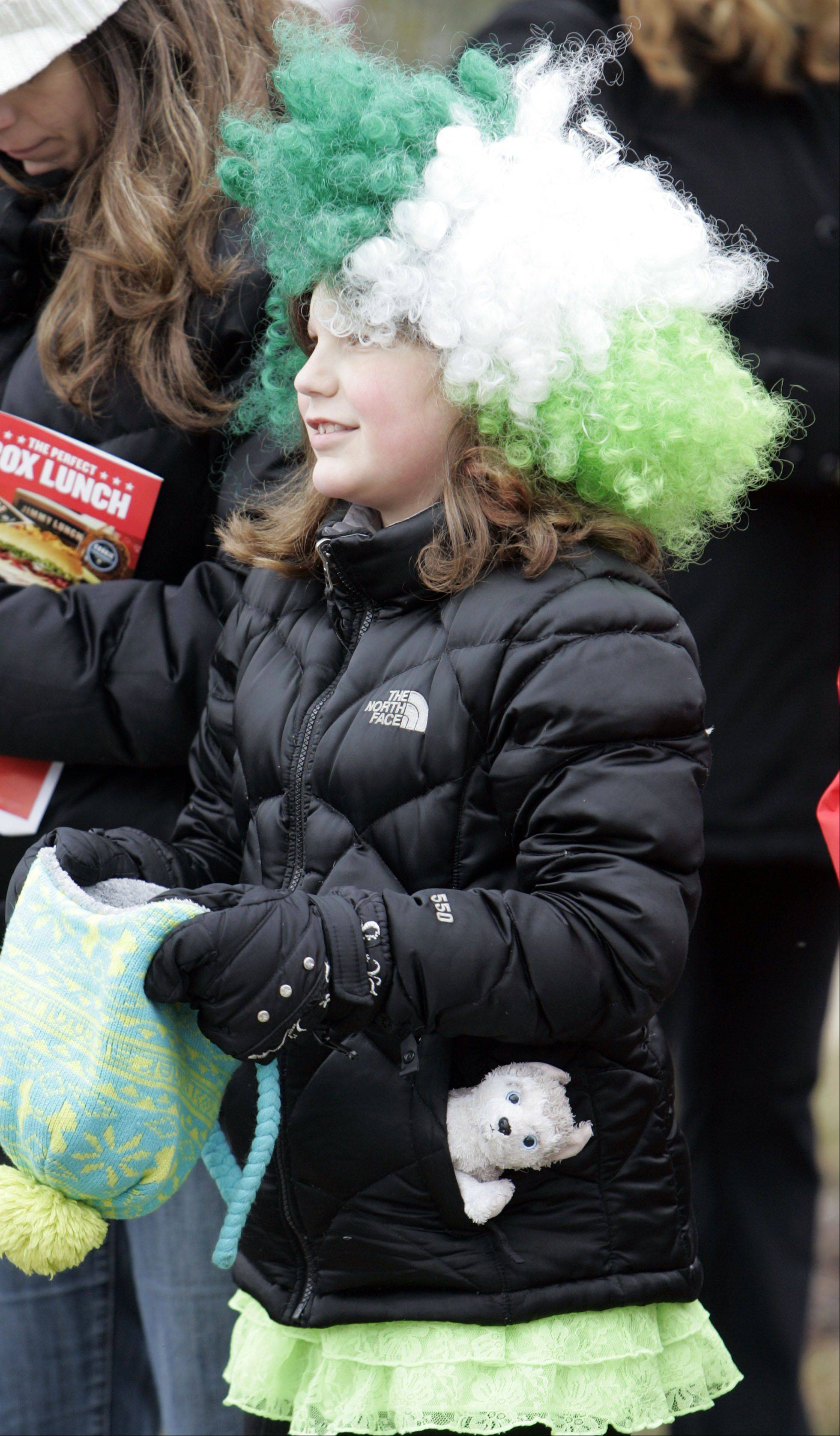 Olivia Guerrieri, 9, of Algonquin wore a green and white wig Saturday to watch the Thom McNamee Memorial St. Patrick's Day Parade in East Dundee.