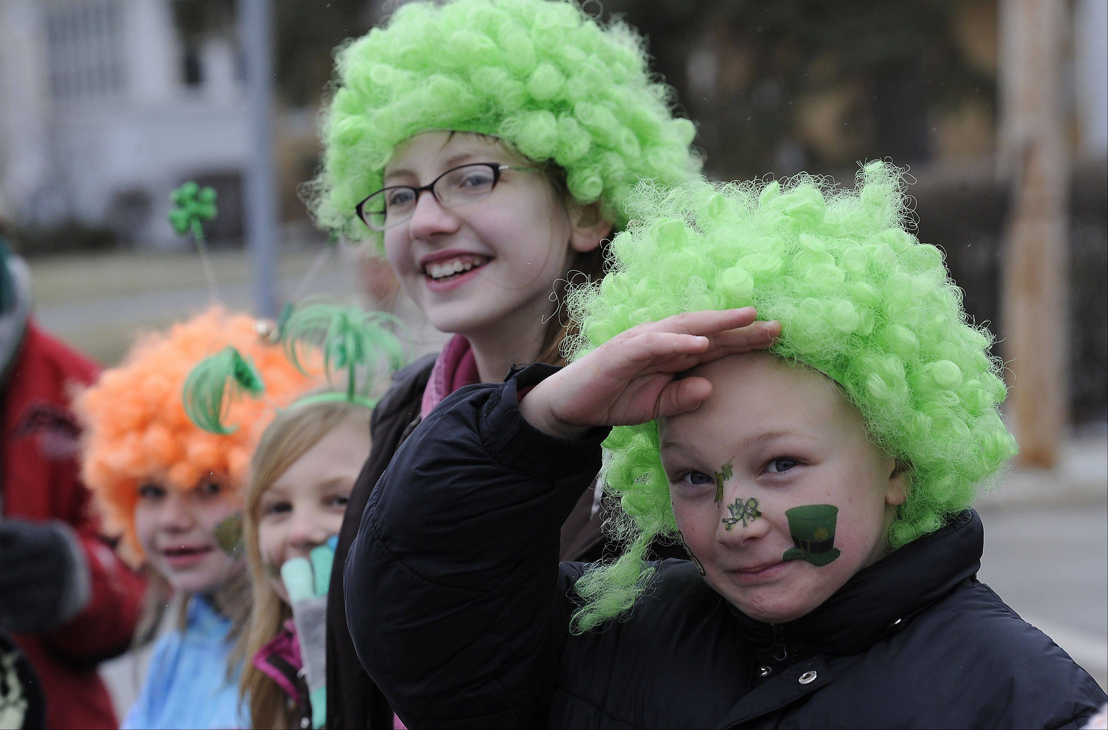 Colin Bertrand, 8, and Sara Walczynski, 10, both of Palatine, enjoy the St. Patrick's day parade Saturday in Palatine, which kicks off the town's Paint the Town Green celebration.