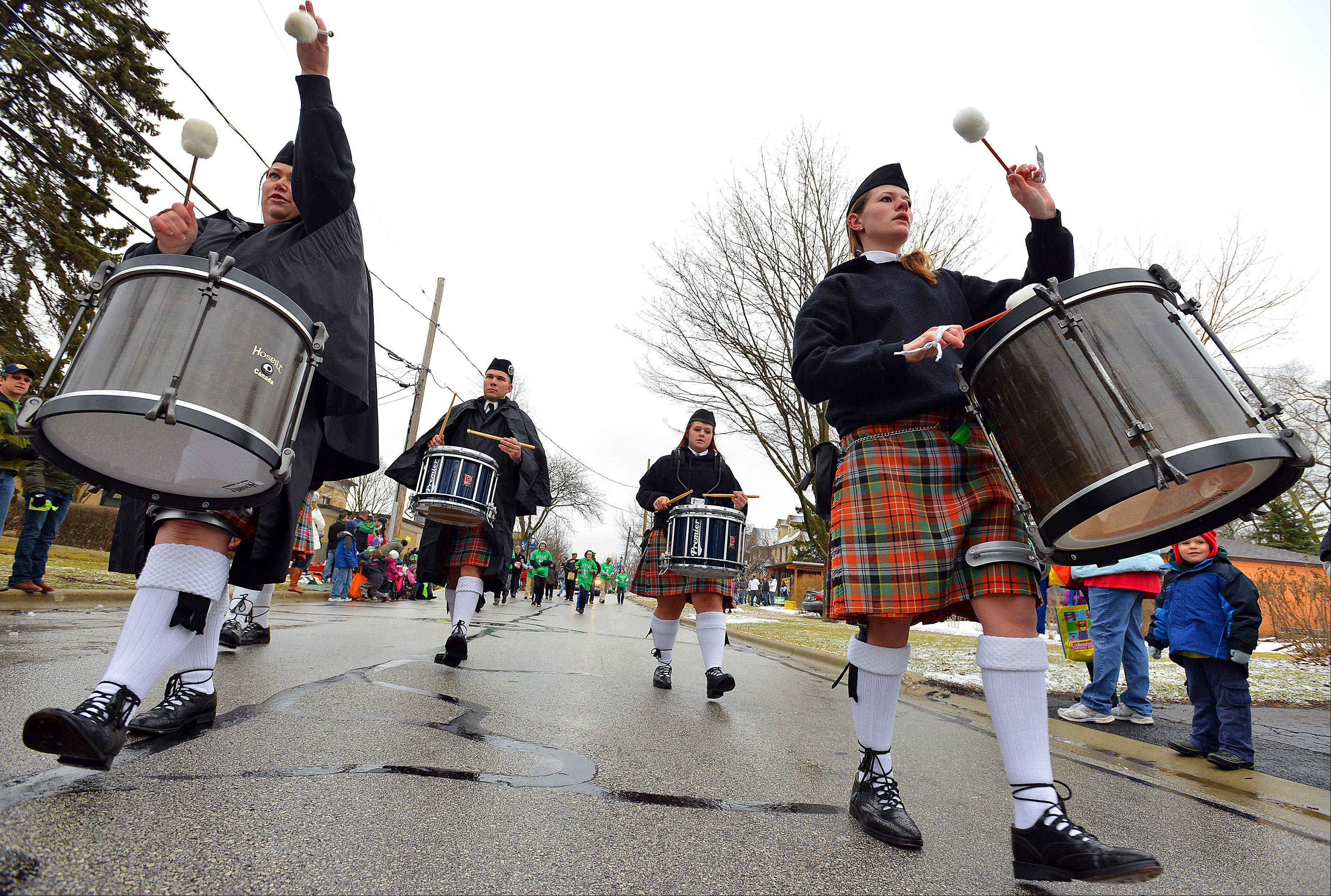 Despite the cold and the snow showers, the Midlothian Pipe Band of Lake Zurich entertained the audience during Saturday's St. Patrick's Day parade in Palatine.
