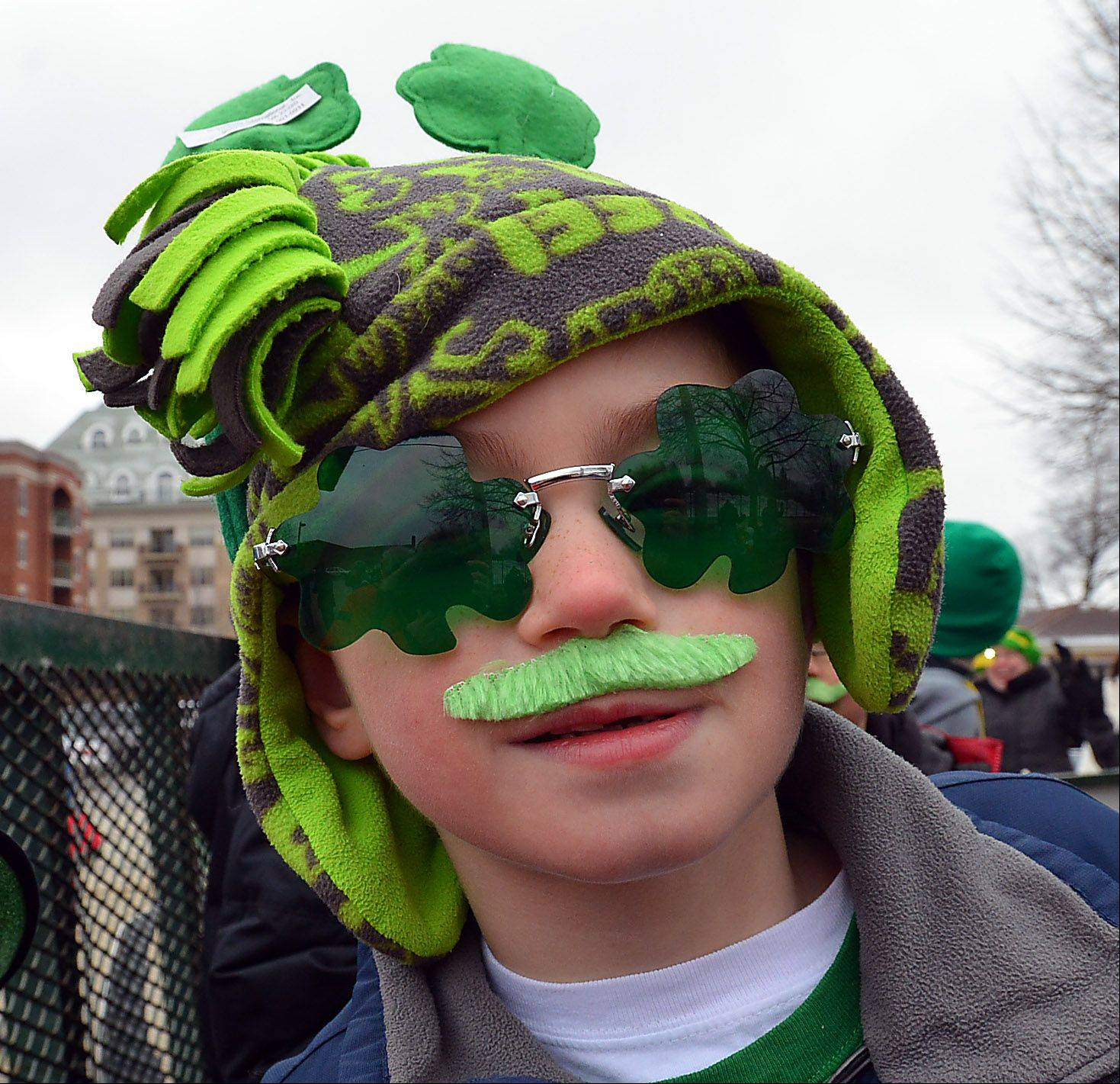Despite the cold and the snow showers, hundreds turned out to enjoy Palatine's St. Patrick's Day parade including Nathan Roos, 8, of Palatine.