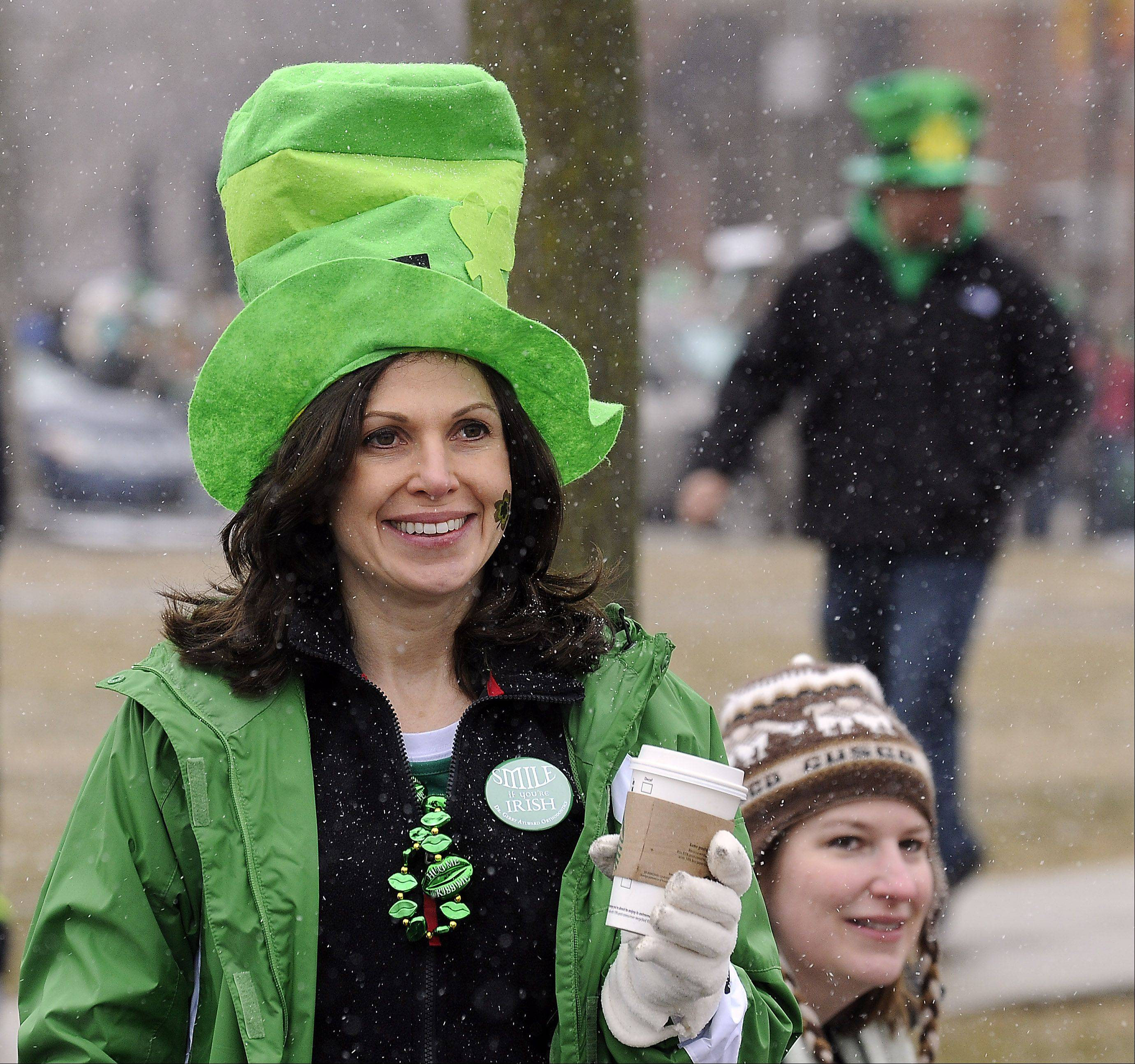 Despite the cold and the snow showers Saturday, hundreds turned out to enjoy the St. Patrick's Day parade in Palatine, including Traci King of Inverness.