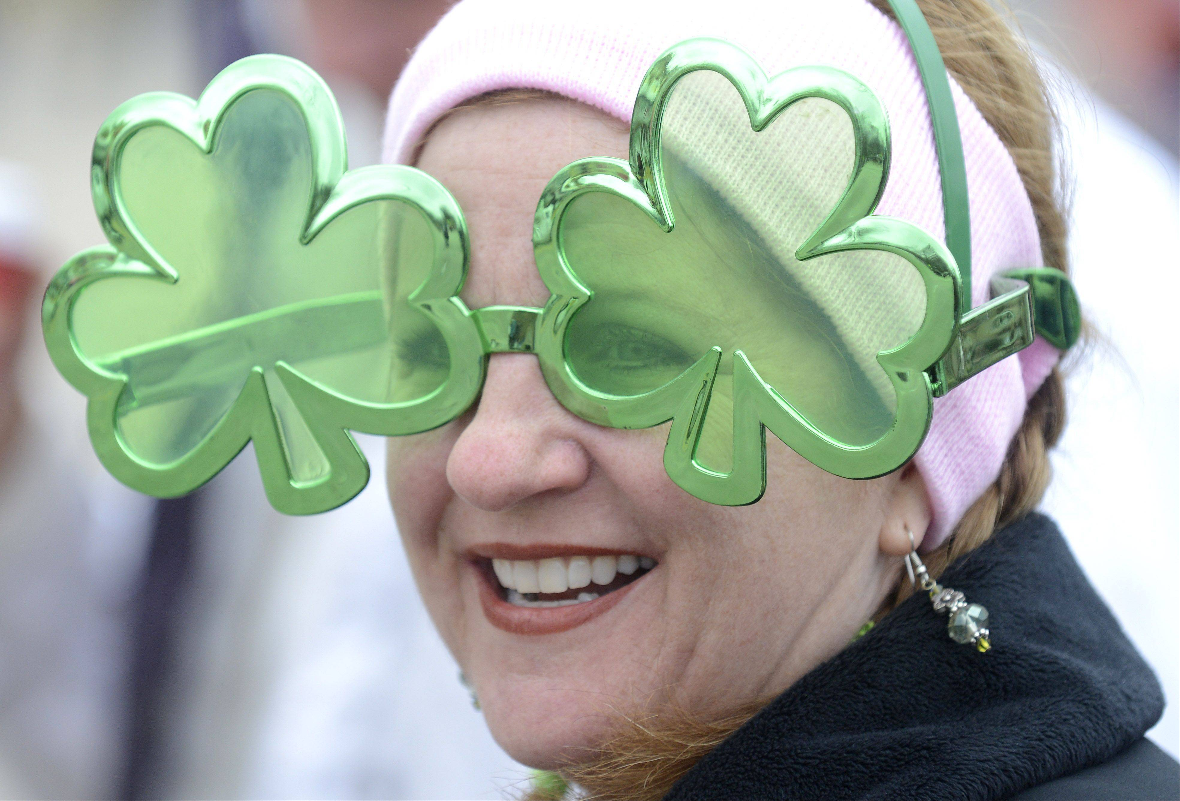 Rond Baird of St. Charles wears the funny shamrock glasses her son, Johnny, 6, did not want to wear at the St. Patrick's Day parade in St. Charles on Saturday.