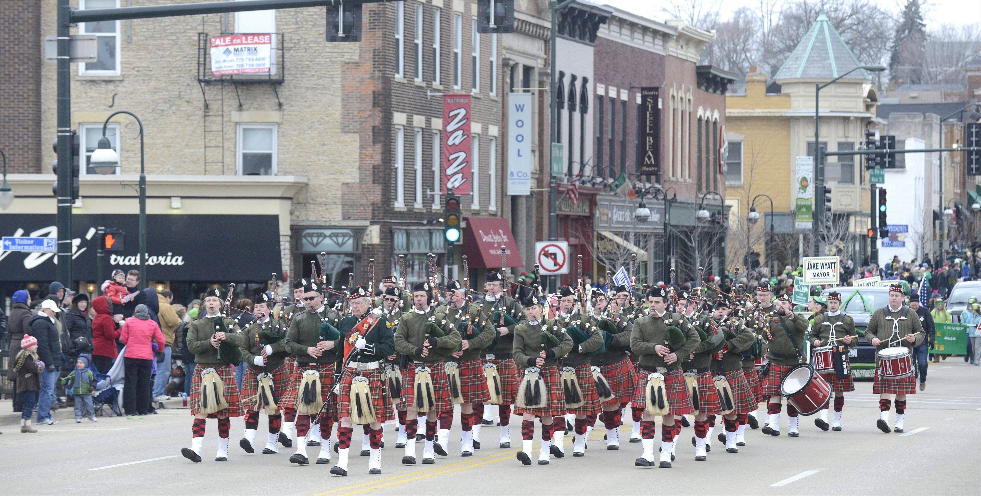 The Chicago Highlanders Pipes and Drums marches down Main Street in the St. Charles St. Patrick's Day parade on Saturday.