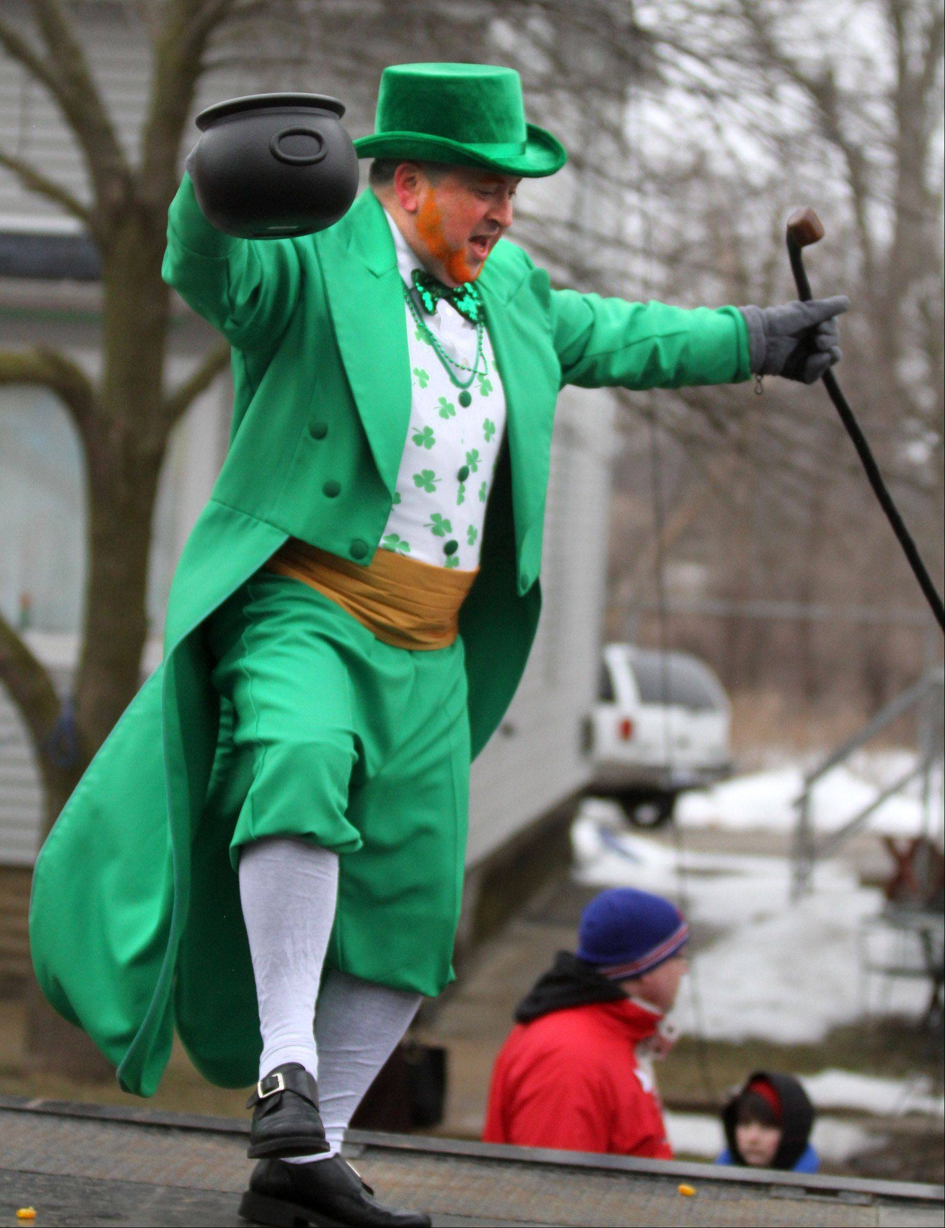 Jack Ruskin of Lake Villa dressed as a leprechaun to ride on the Fox Recovery and Towing flatbed float in the Lake Villa St. Patrick's Day parade on Saturday.