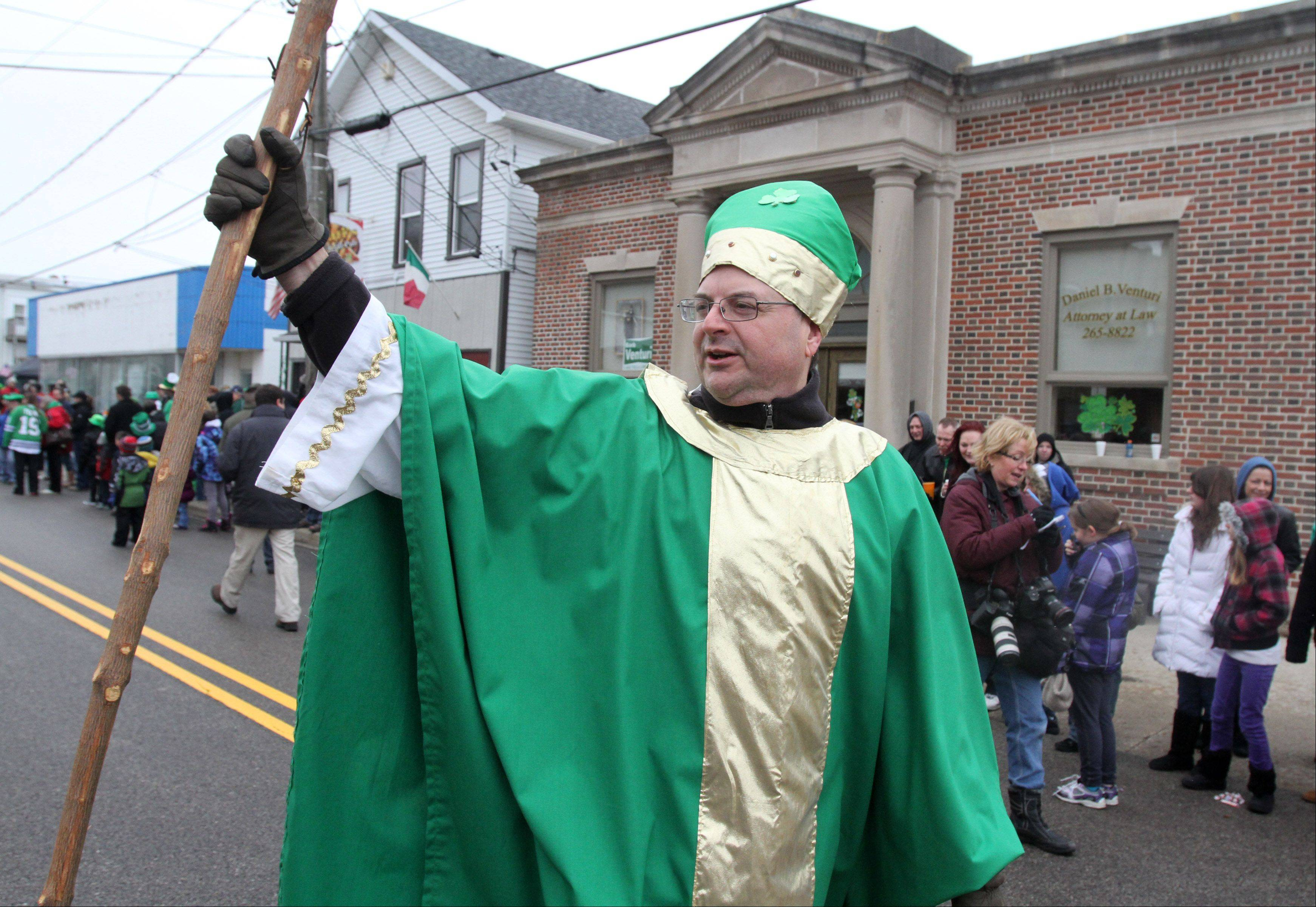 Jim Barnowski of Lake Villa -- dressed as St. Patrick himself -- marches in the Lake Villa St. Patrick's Day parade on Saturday.