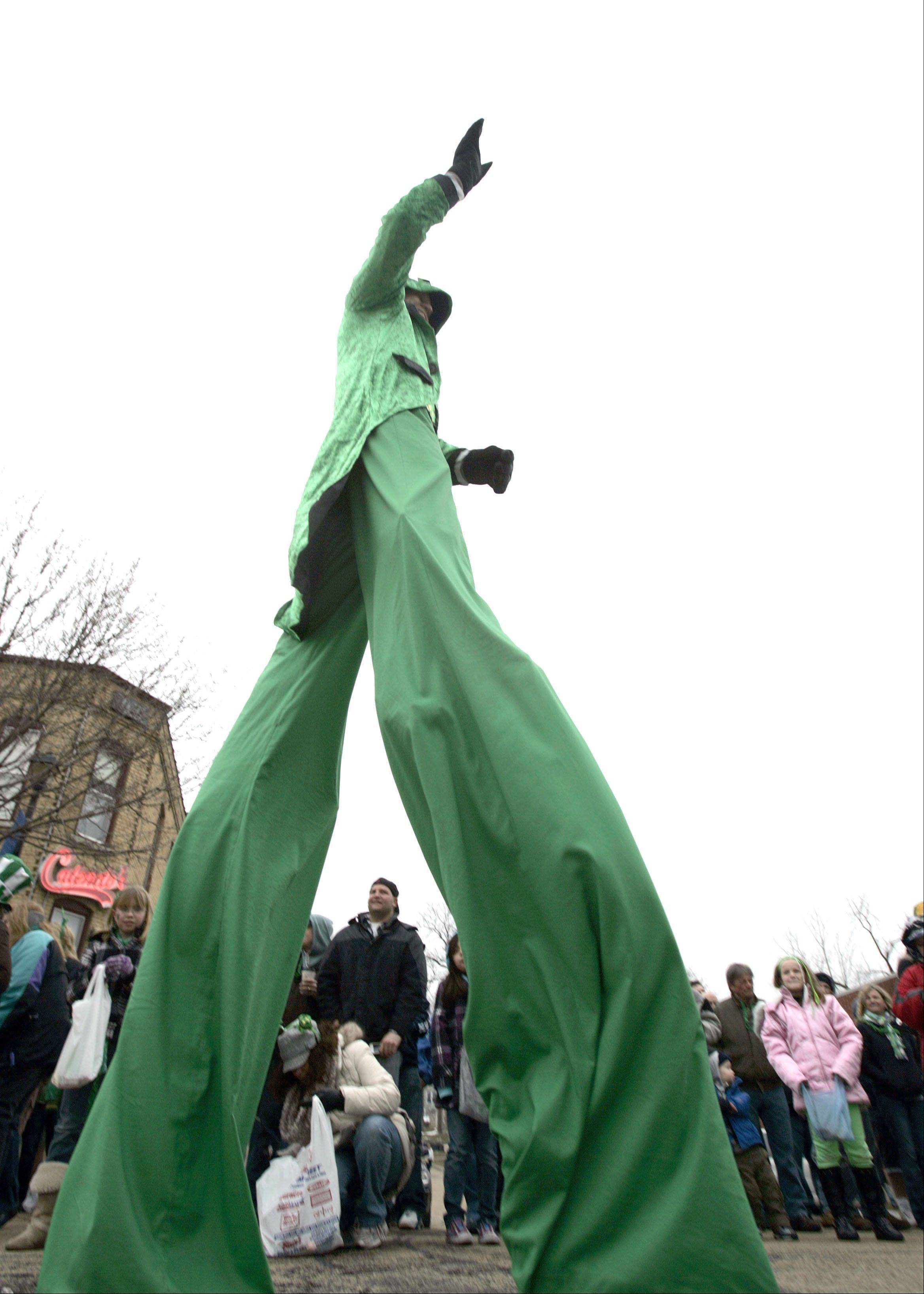 Brian Hampton of Aerial Storm dressed in green from head to toe to walk in the Thom McNamee Memorial St. Patrick's Day Parade Saturday in East Dundee.
