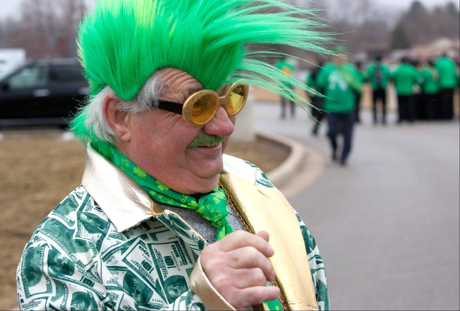 Bob Ryan sports a green Mohawk as part of his St. Patrick's Day Parade attire as he prepares to walk Saturday with Marquette Companies of Naperville.