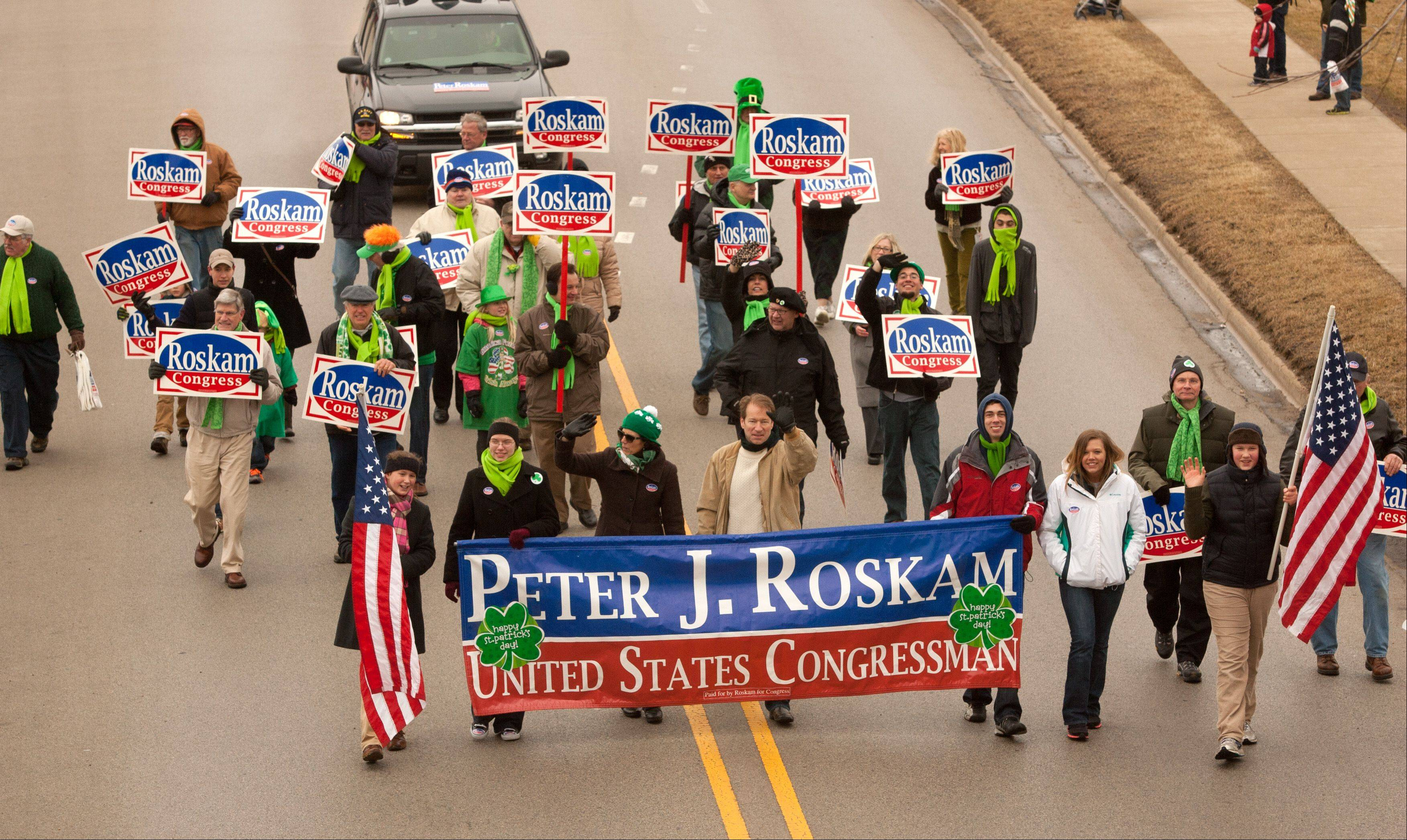 U.S. Rep. Peter Roskam and a group of his supporters march Saturday in Naperville's St. Patrick's Day Parade.