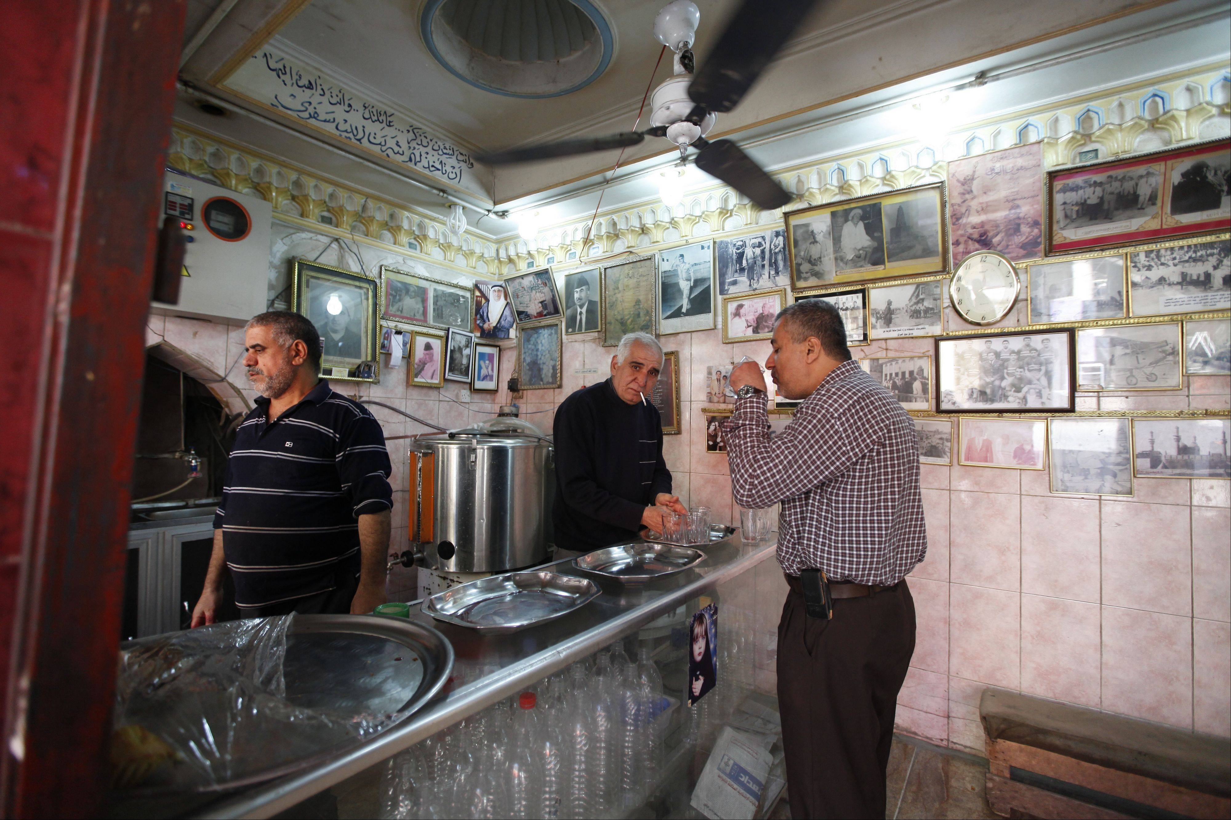 A customer sips juice at the Haji Zebala juice shop in Baghdad. It's easy to forget about the war's hardships inside the shop on the capital's historic Rasheed Street, where they�re still serving up fresh-pressed grape juice like they have for generations.
