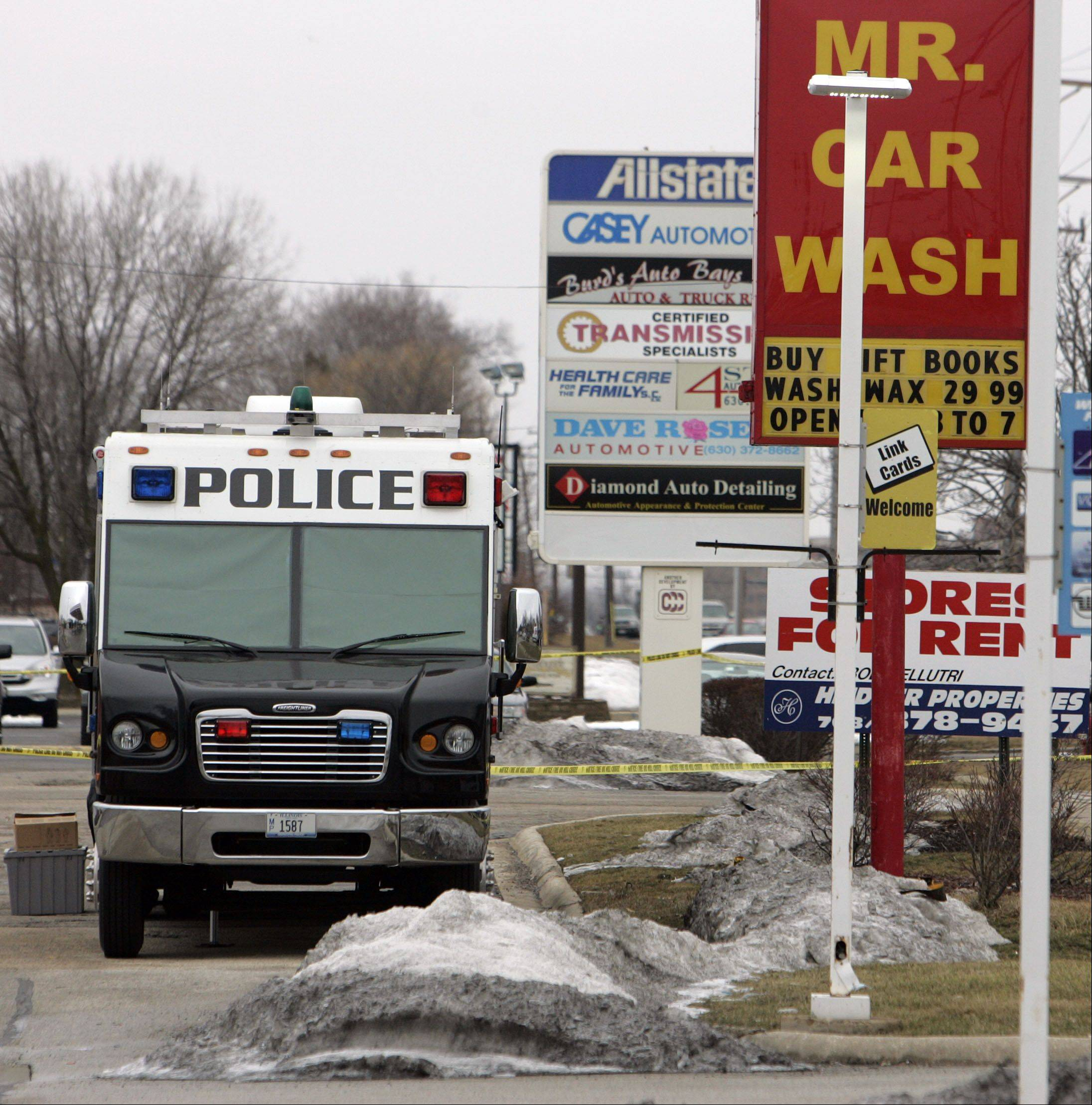 Streamwood police work the scene where a gas station clerk was stabbed and killed early Saturday morning in Streamwood, police said.