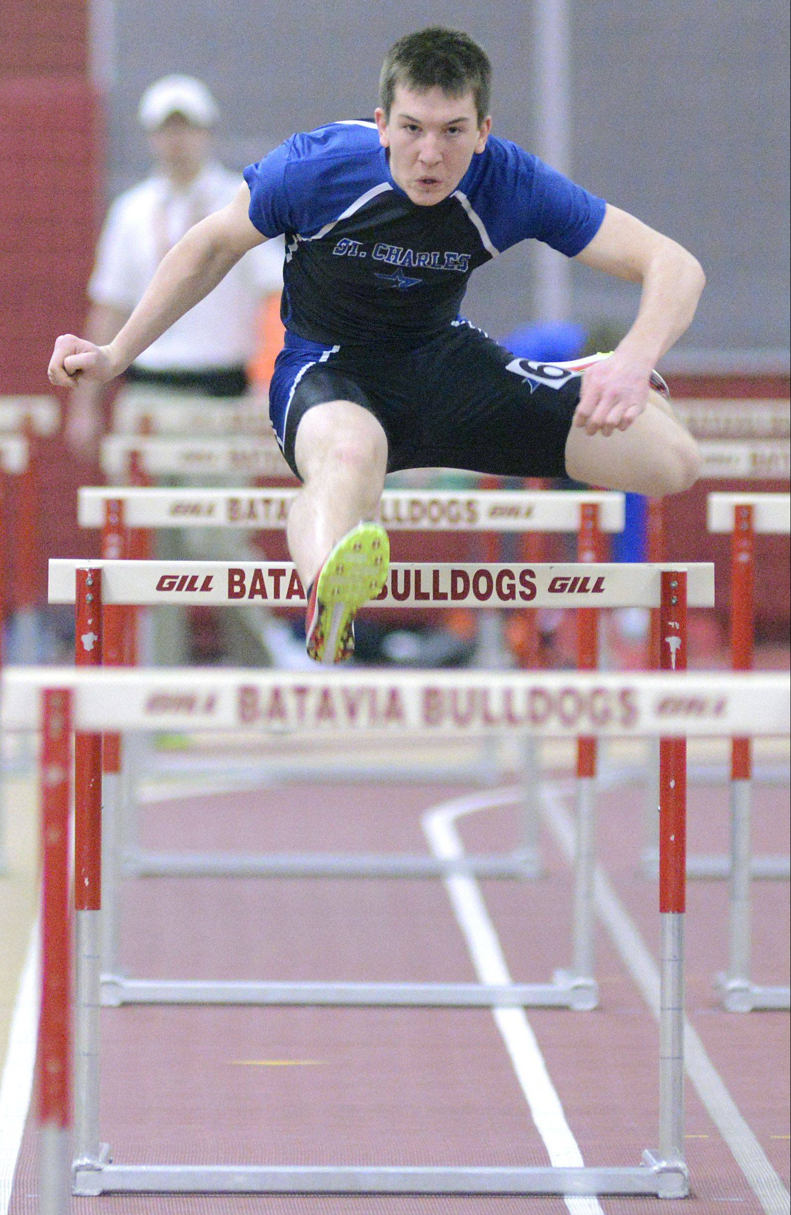 Above: St. Charles North's Mason Heinz runs the 55 meter hurdles at the Upstate Eight Conference meet in Batavia on Saturday. Below, left to right: St. Charles East's Ryan Memije, Geneva's Nate Wendt and Batavia's Mitch Zabka.