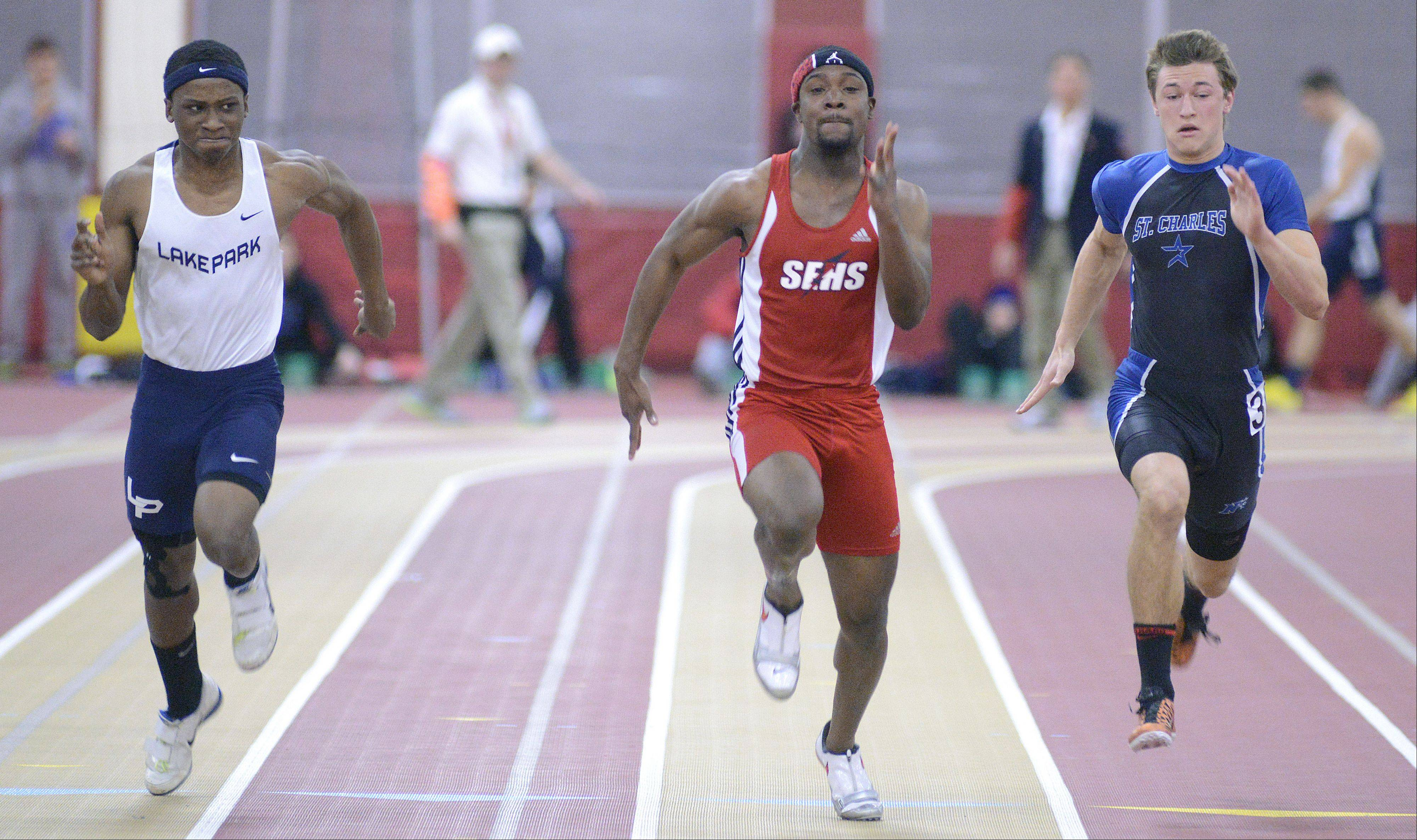 Lake Park's Marcus Jegede, South Elgin's Jeff Broger and St. Charles' North's Josh Phelan in the second heat of the 55 meter dash prelim at the Upstate Eight Conference in Batavia on Saturday, March 16.