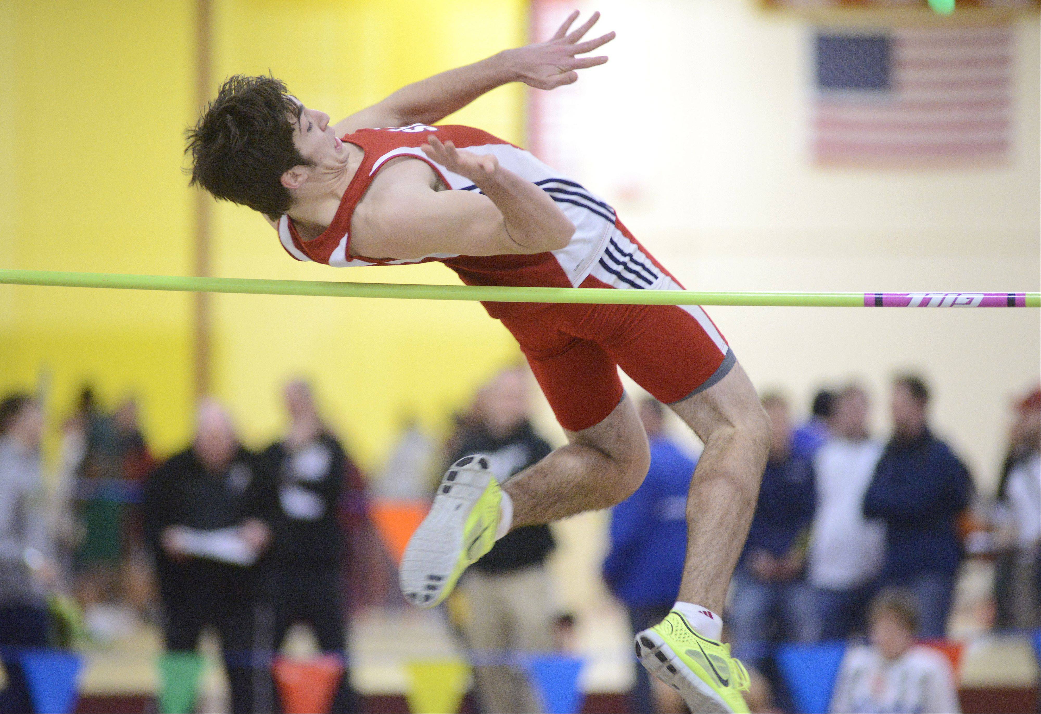 South Elgin's Kyle Kumerow competes in the high jump at the Upstate Eight Conference indoor meet at Batavia on Saturday.