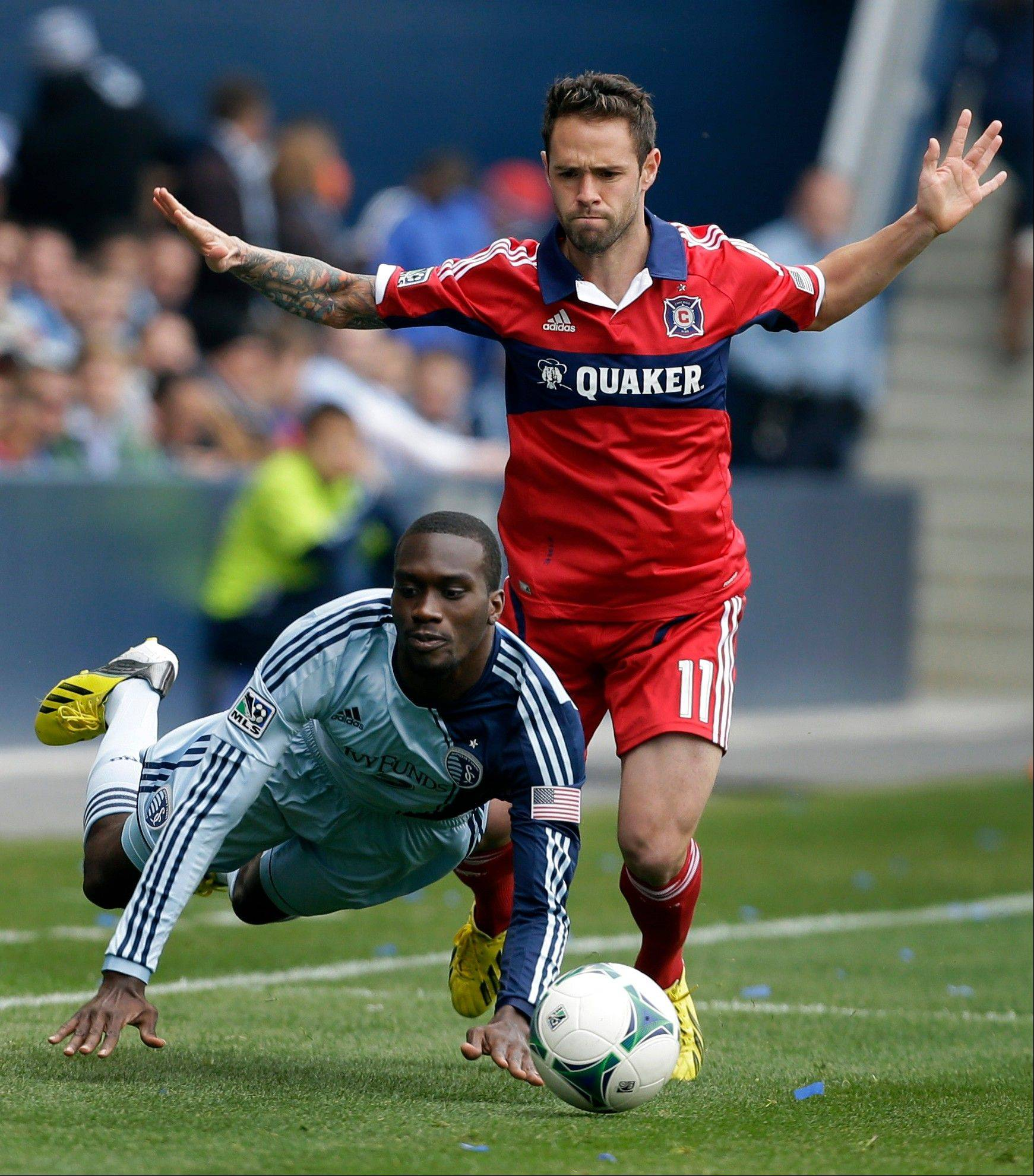 Chicago Fire midfielder Bobby Convey (11) knocks down Sporting Kansas City forward C.J. Sapong (17) during the first half of an MLS soccer match in Kansas City, Kan., Saturday, March 16, 2013.