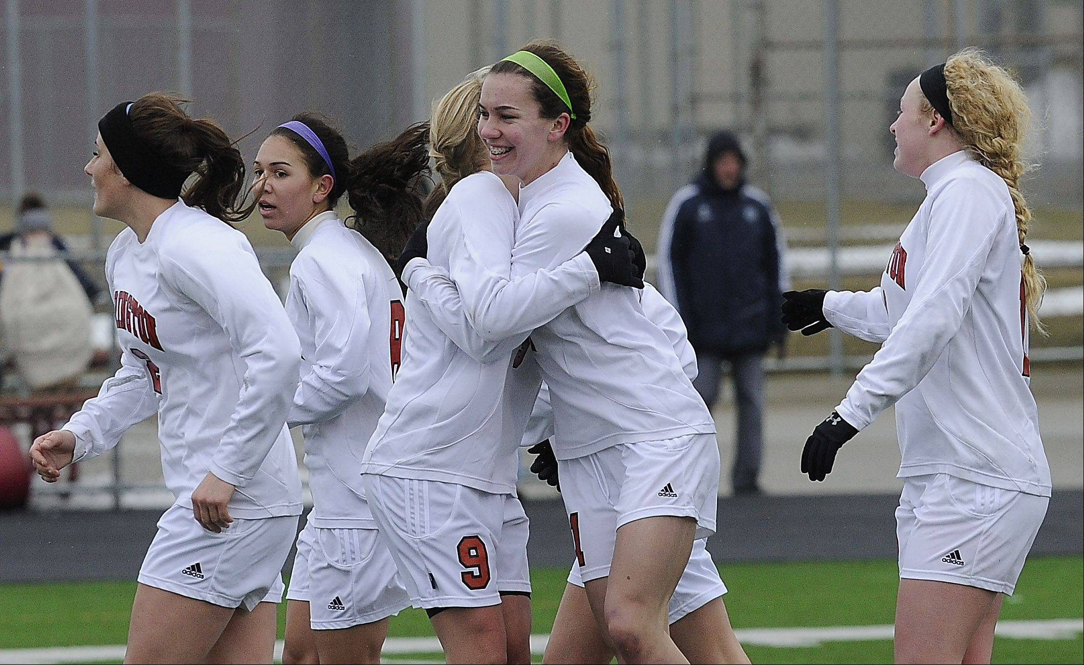 Jenna Szczesny of Barrington, middle, celebrates her goal in the second half against visiting Neuqua Valley on Saturday.