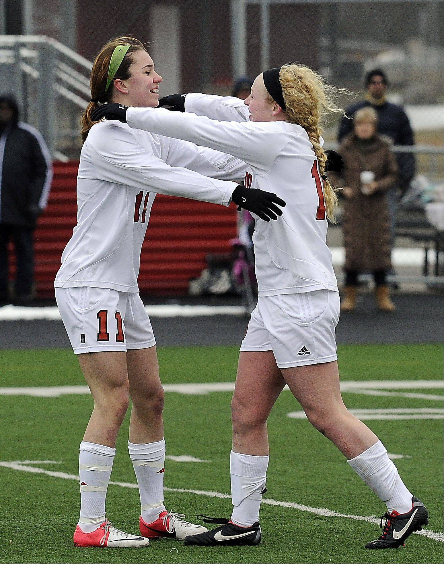 Jenna Szczesny, left, of Barrington celebrates her goal in the second half against visiting Neuqua Valley on Saturday.