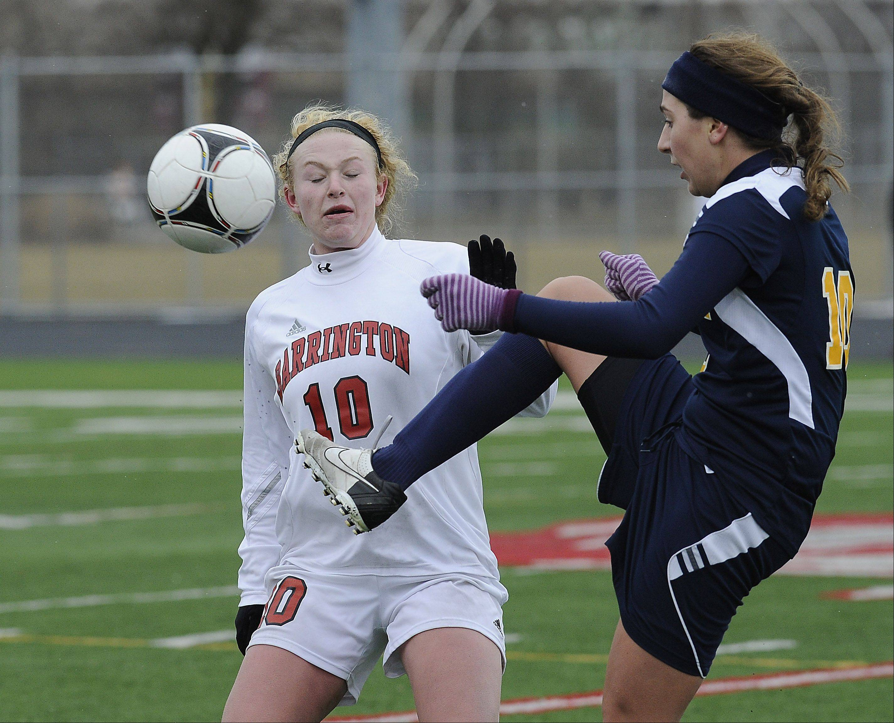 Molly Pfeiffer nearly gets kicked as Neuqua Valley's Brooke Ksiazek takes control of the ball in the second half at Barrington on Saturday.