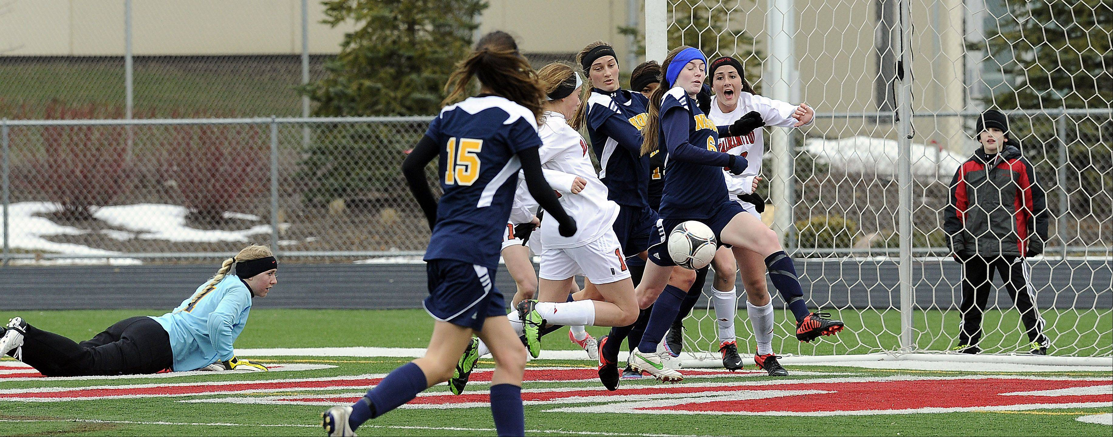 Barrington's Kelsey Muniz nearly scores in the second half, but Neuqua Valley's Sophia Moreau deflects her shot in nonconference play Saturday at Barrington.