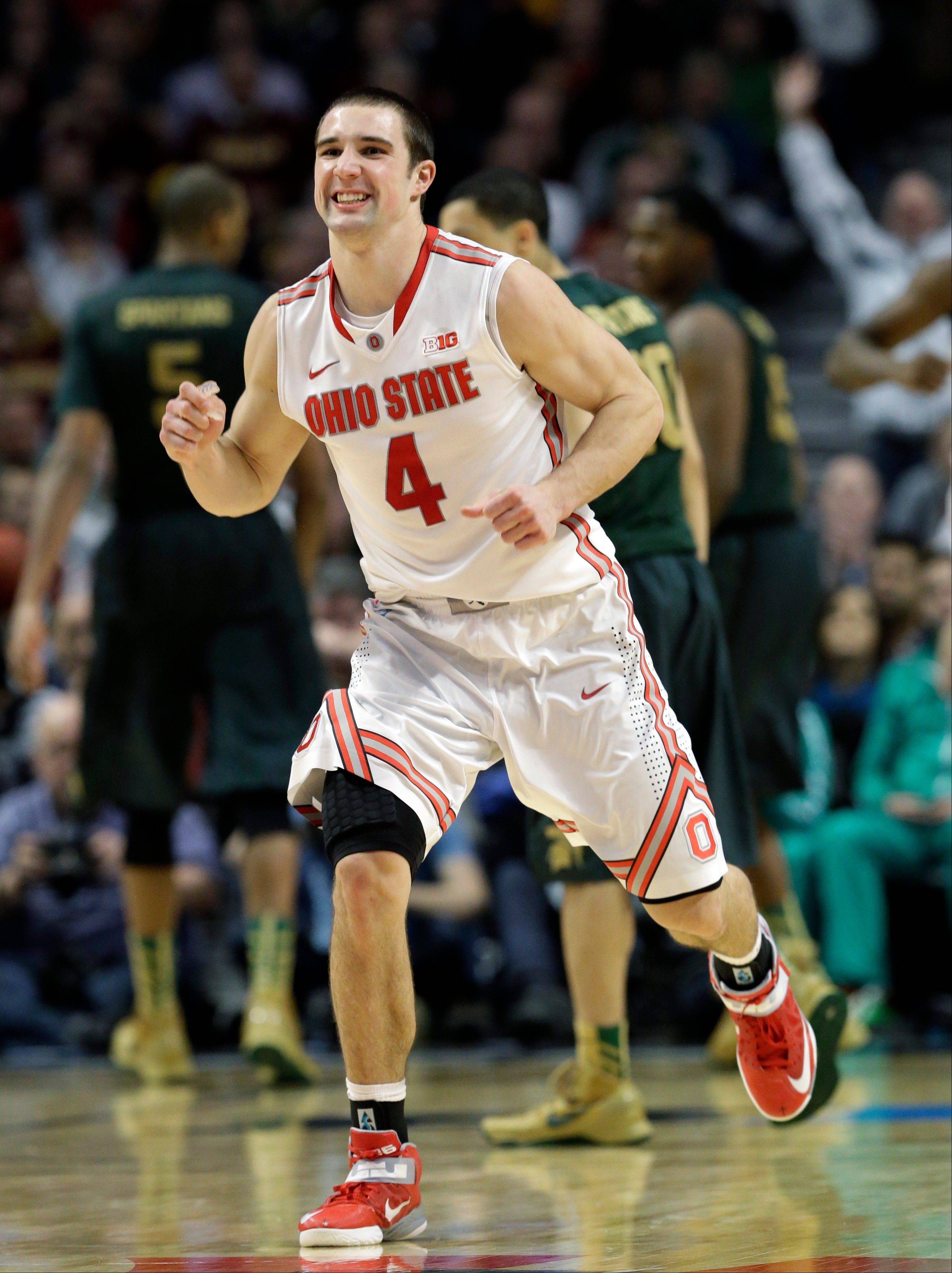 Ohio State's Aaron Craft reacts during the second half of an NCAA college basketball game against Michigan State at the Big Ten tournament Saturday, March 16, 2013, in Chicago. Ohio State won 61-58.