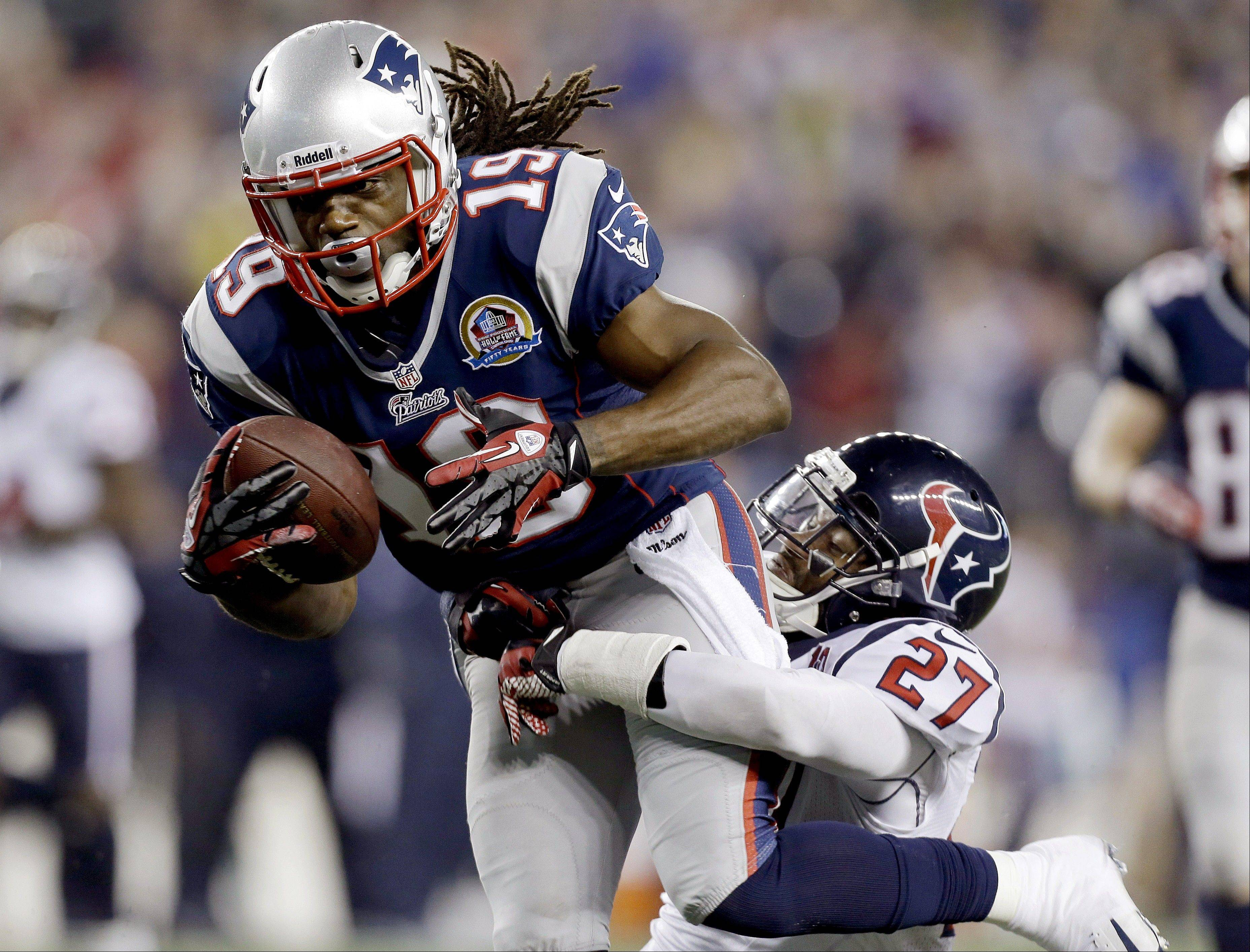 FILE - In this Dec. 10, 2012, file photo, New England Patriots wide receiver Donte' Stallworth (19) dives into the end zone for a touchdown while dragging Houston Texans defensive back Quintin Demps, right, during the third quarter of an NFL football game in Foxborough, Mass. Stallworth, a free agent, was hospitalized Saturday, March 16, 2013, with serious burns after the hot air balloon carrying him and two other people crashed into power lines above South Florida, his agent, Drew Rosenhaus, said.