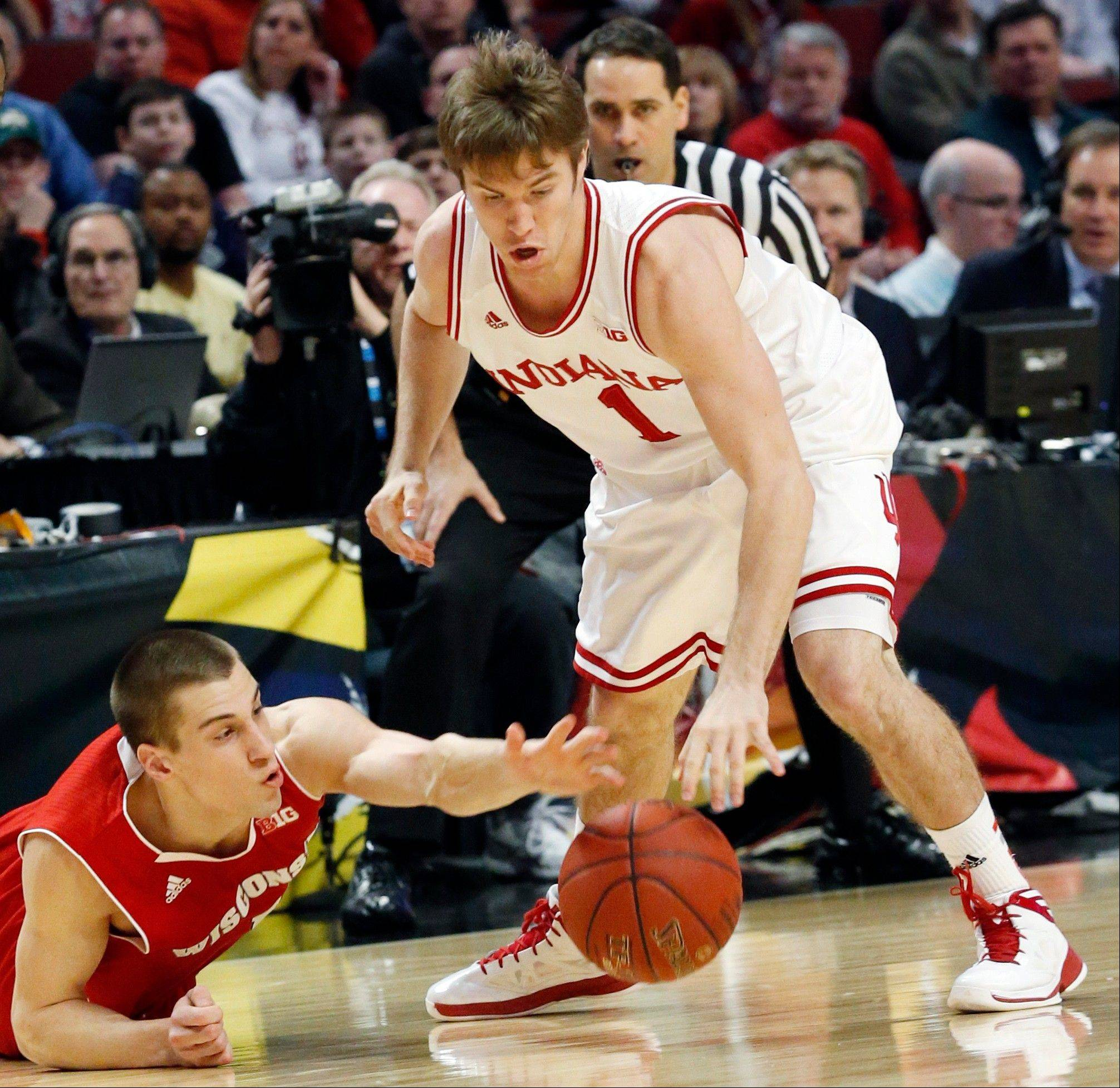 Wisconsin's Ben Brust and Indiana's Jordan Hulls battle for a loose ball during the first half of an NCAA college basketball game at the Big Ten tournament Saturday, March 16, 2013, in Chicago.