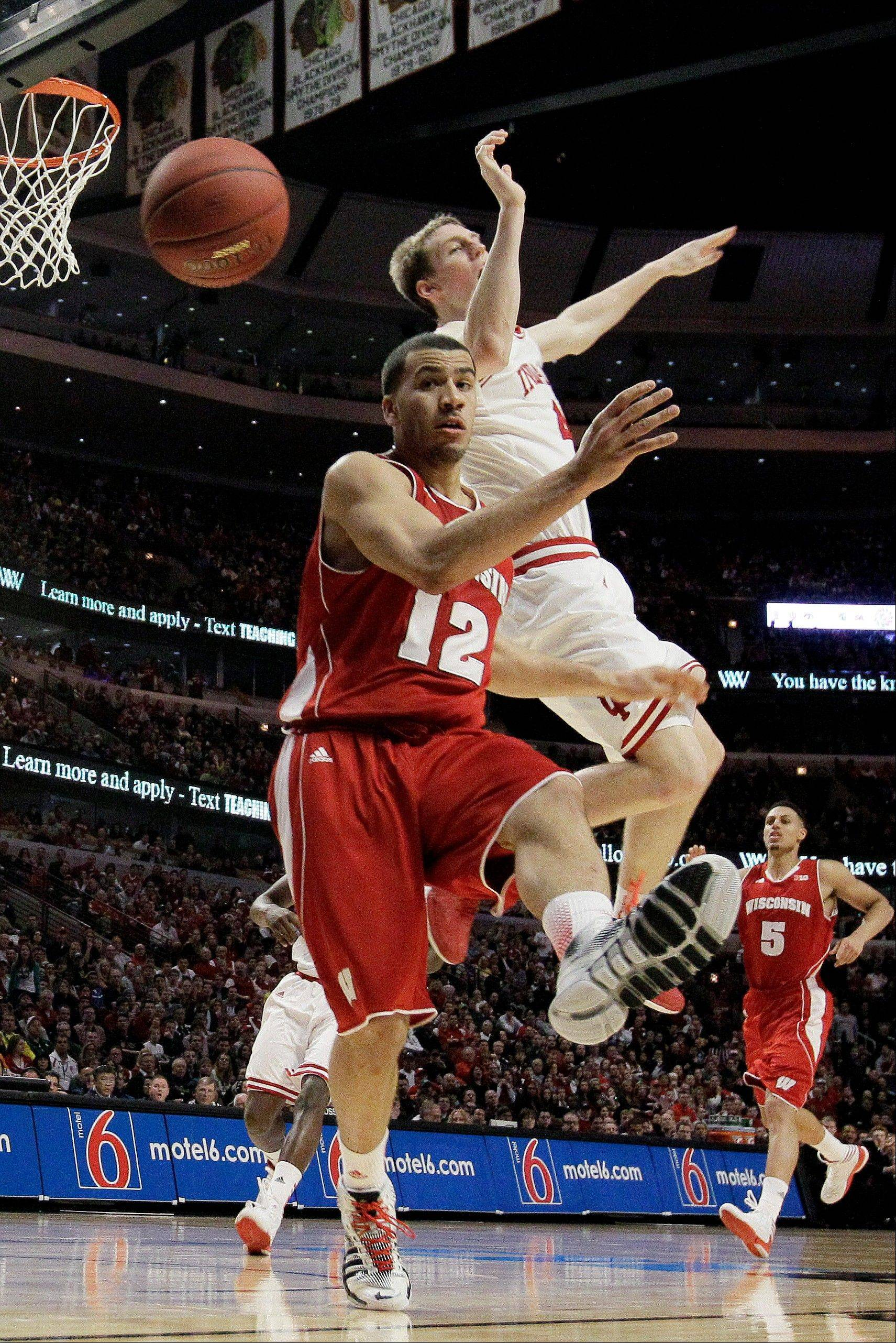 Wisconsin's Traevon Jackson (12) and Indiana's Cody Zeller go after a loose ball during the second half of an NCAA college basketball game at the Big Ten tournament Saturday, March 16, 2013, in Chicago. Wisconsin won 68-56.