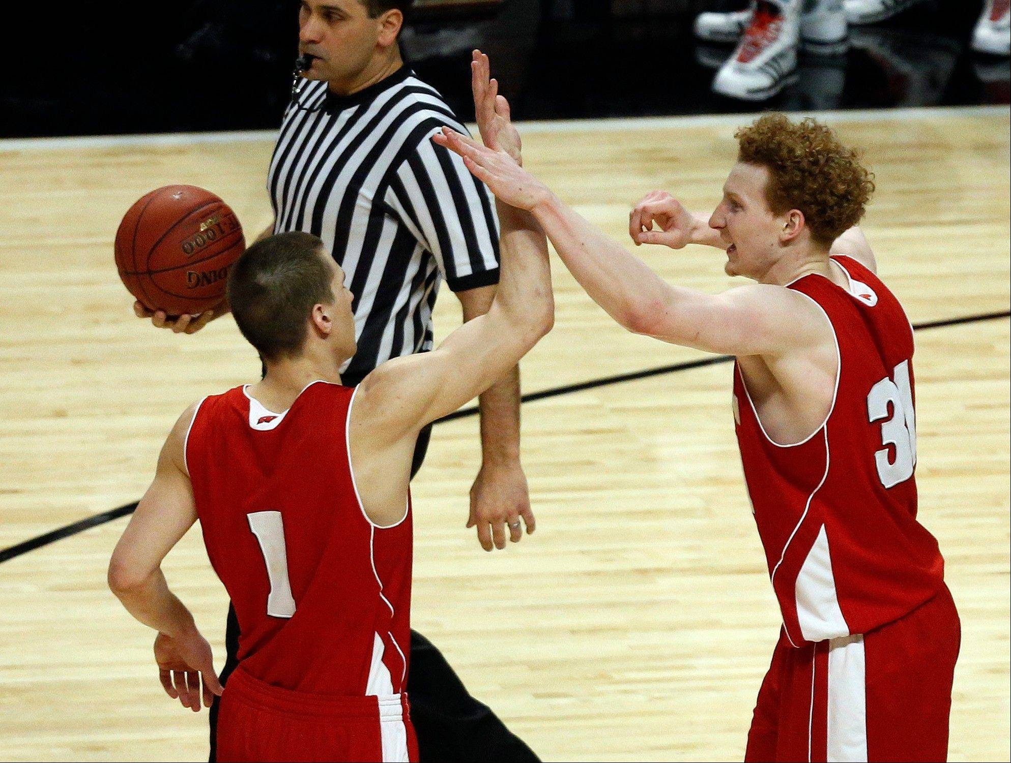 Wisconsin's Mike Bruesewitz (31) celebrates with Ben Brust (1) during the final minute in the second half of an NCAA college basketball game against Indiana at the Big Ten tournament Saturday, March 16, 2013, in Chicago. Wisconsin won 68-56.