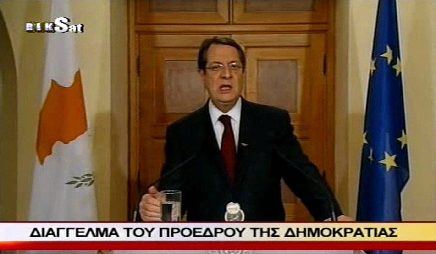 In this image made from video, Cyprus' president Nikos Anastasiades addresses the nation in a televised broadcast Sunday. He said he is trying to amend a detested bailout plan that would tax bank deposits across the country to reduce its effect on small savers.