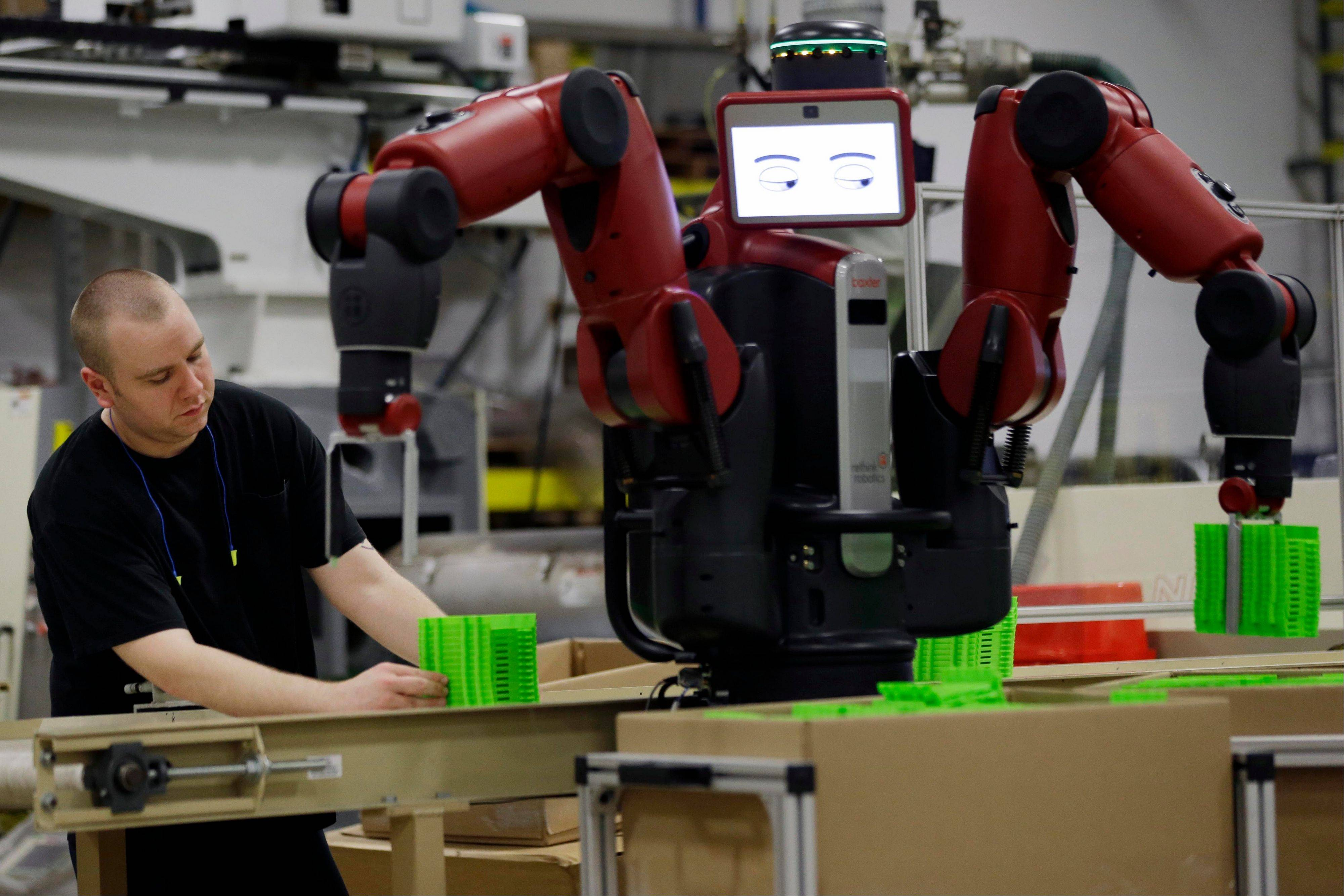 A technician works with Baxter, an adaptive manufacturing robot created by Rethink Robotics at The Rodon Group manufacturing facility, Tuesday in Hatfield, Pa. There are three jobs open at Rodon Group, a plastic parts manufacturer near Philadelphia. But despite the reports of a shortage of skilled workers nationwide, CEO Michael Araten isn't sweating it.