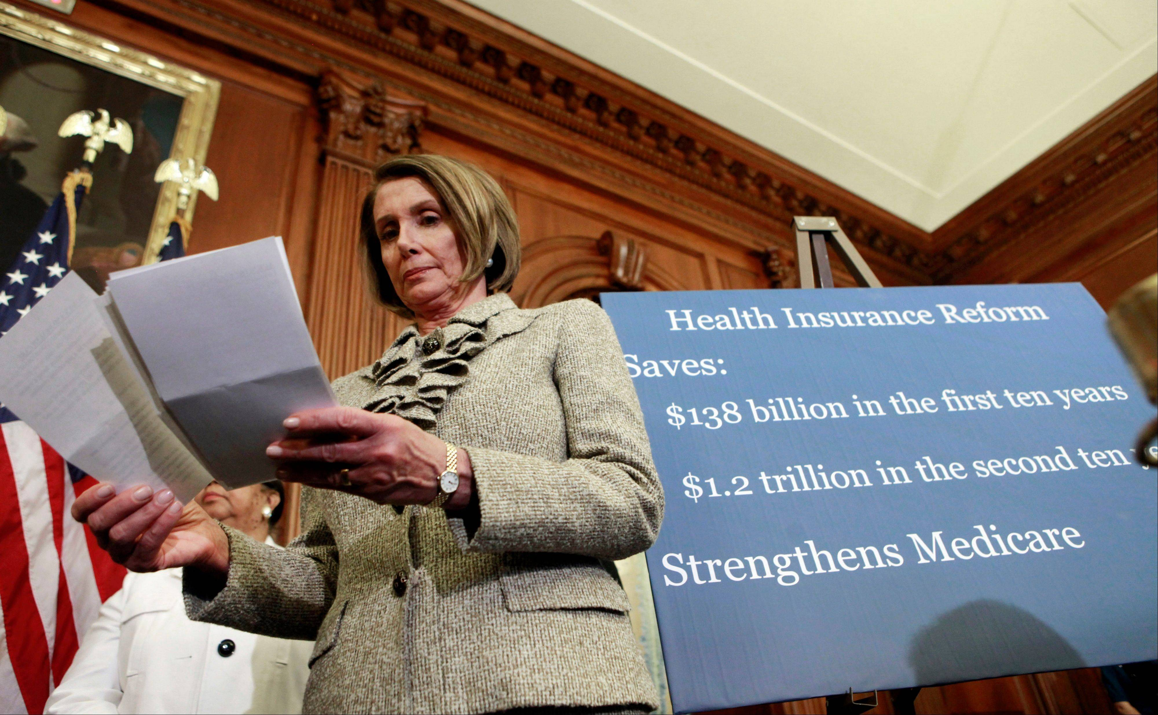 Then-House Speaker Nancy Pelosi, a California Democrat, looks over her notes during a news conference on health care on Capitol Hill in Washington. Some Americans could see their insurance costs double this year as the U.S. health care overhaul expands coverage to millions of people.