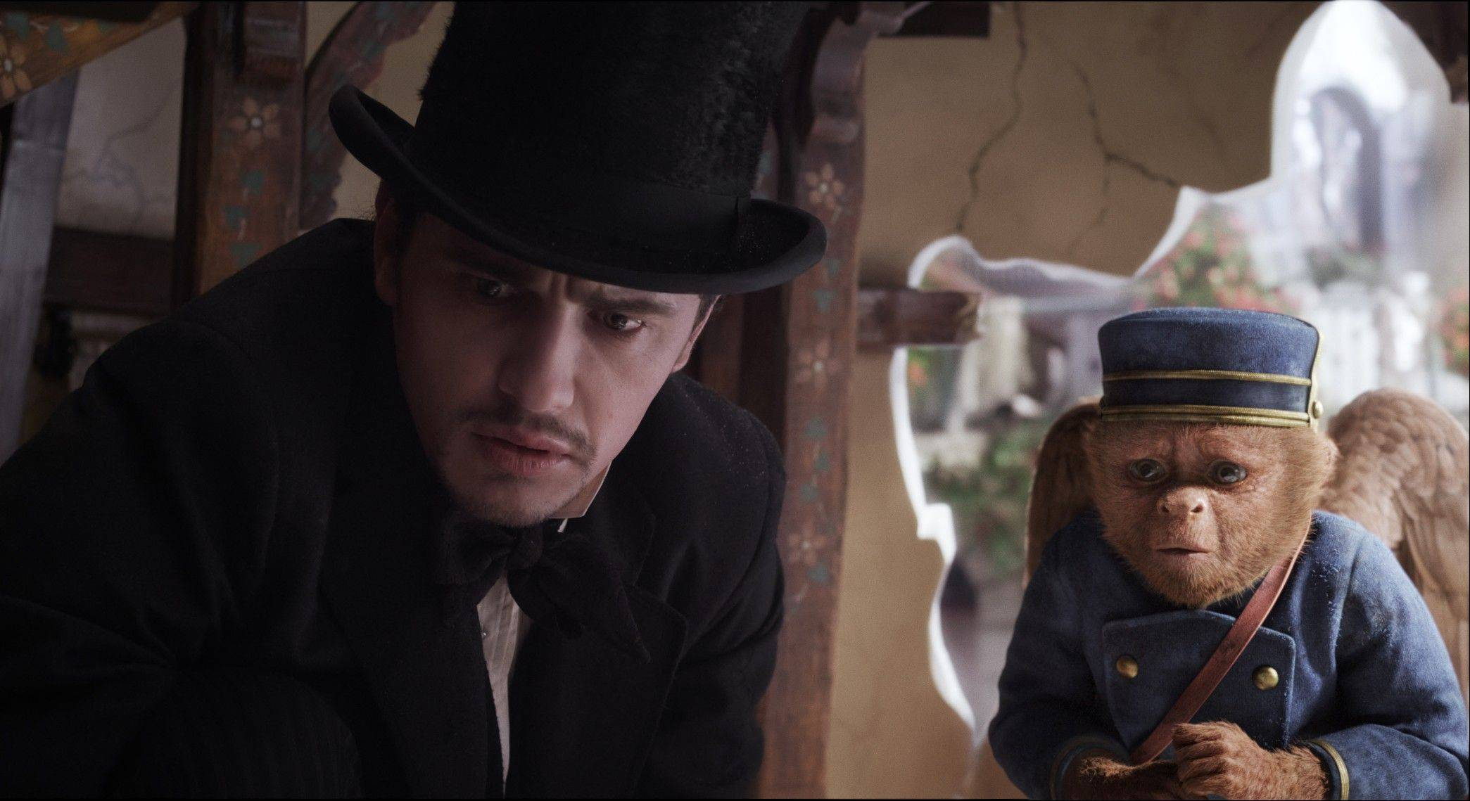 "This file film image provided by Disney Enterprises shows James Franco, as Oz, left, and the character Finley, voiced by Zach Braff, in a scene from ""Oz the Great and Powerful."" The Walt Disney 3-D blockbuster has led all films for the second week in a row, taking in $42.2 million according to studio estimates Sunday, March 17, 2013."