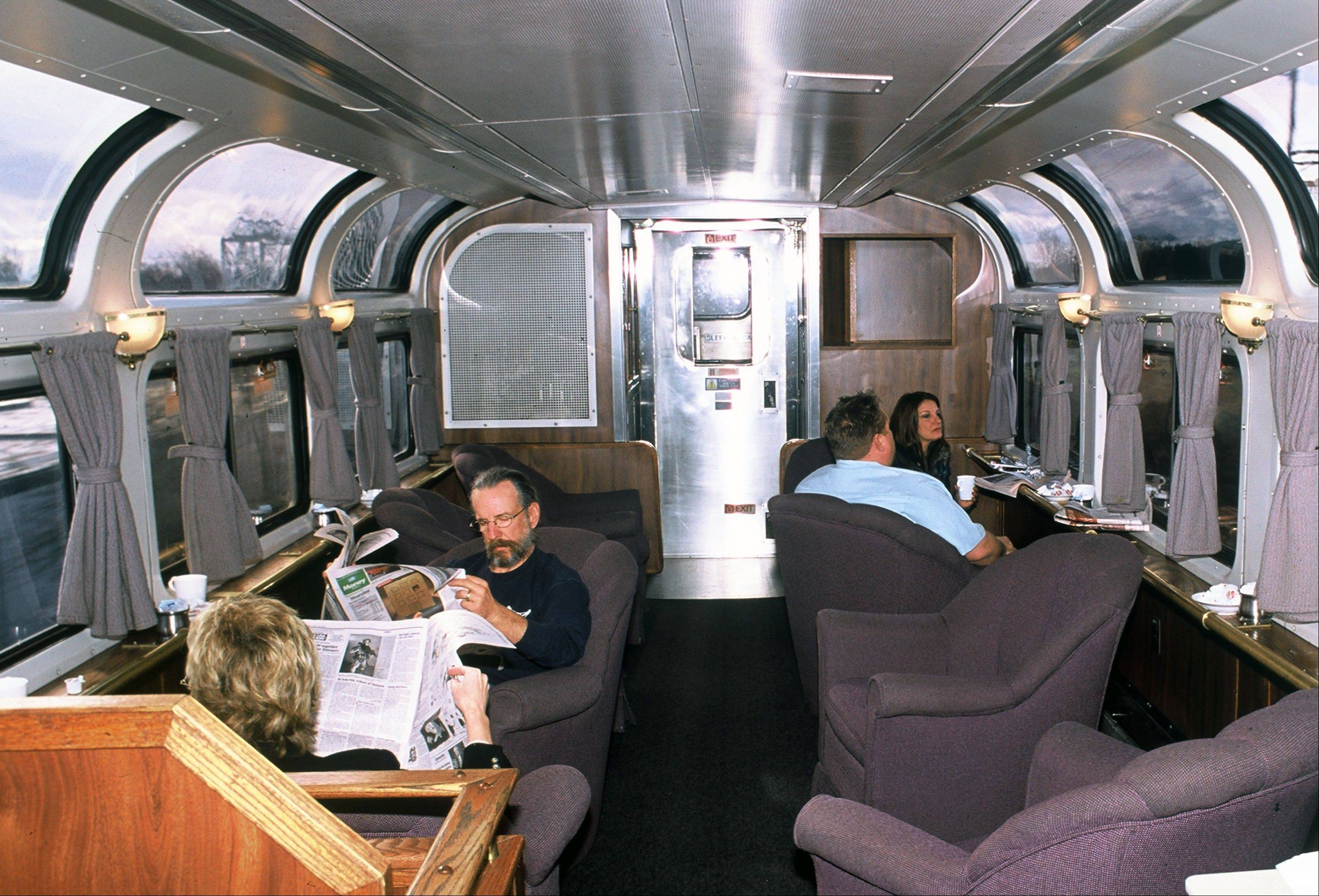 Passengers relax in a lounge car aboard the California Zephyr, which runs between Emeryville, Calif., and Reno, Nev. The train crosses the Sierra Nevada mountain range and follows the same course as the historic Transcontinental Railroad.