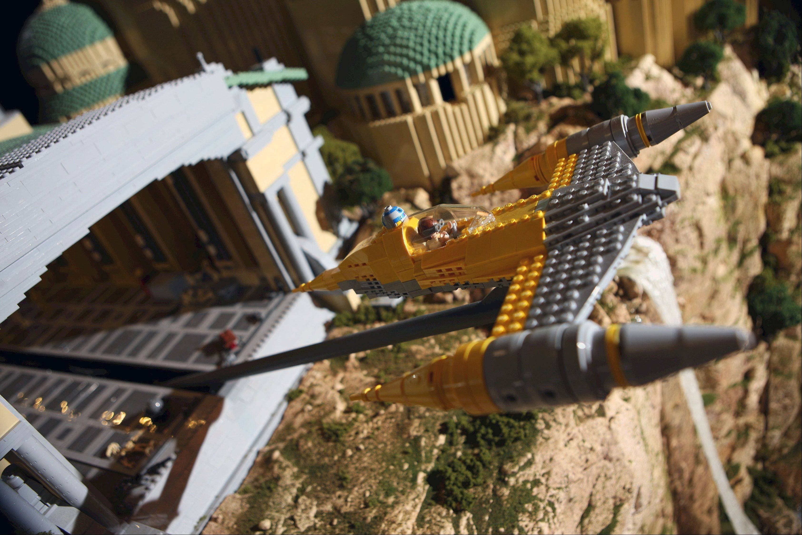"Kids can take control of model ships and have them take off from the domed palace on the planet Naboo as part of the new ""Star Wars"" exhibit."