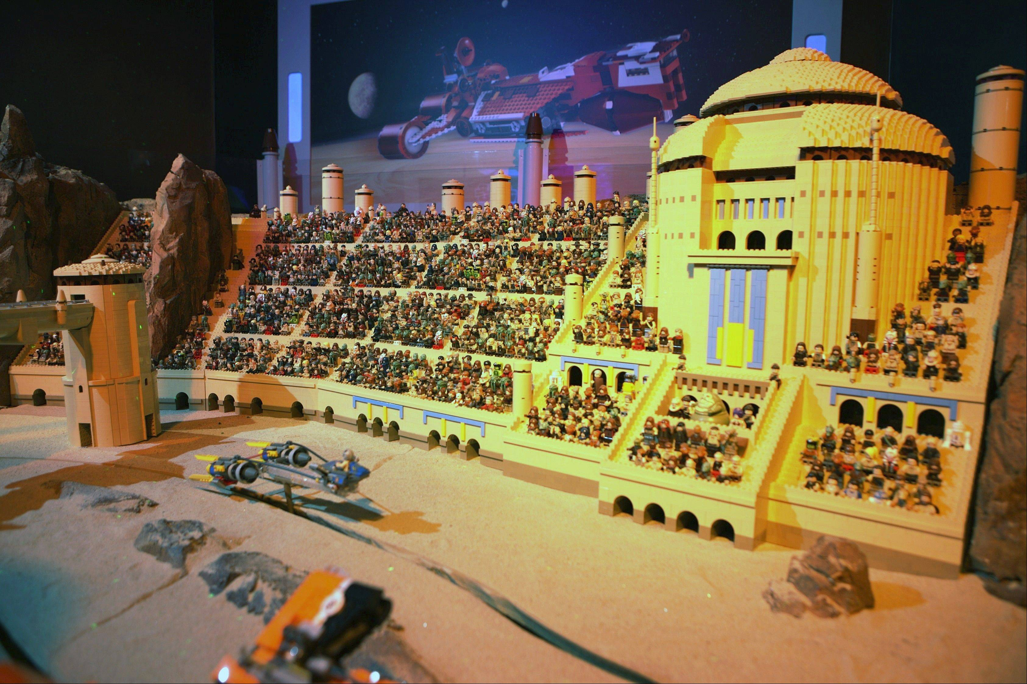"At the ""Lego Star Wars Miniland"" exhibit, small pods can be steered along Tatooine's desert landscape and past stands populated by hundreds of figures representing a scene from ""Star Wars: Episode I -- The Phantom Menace."""