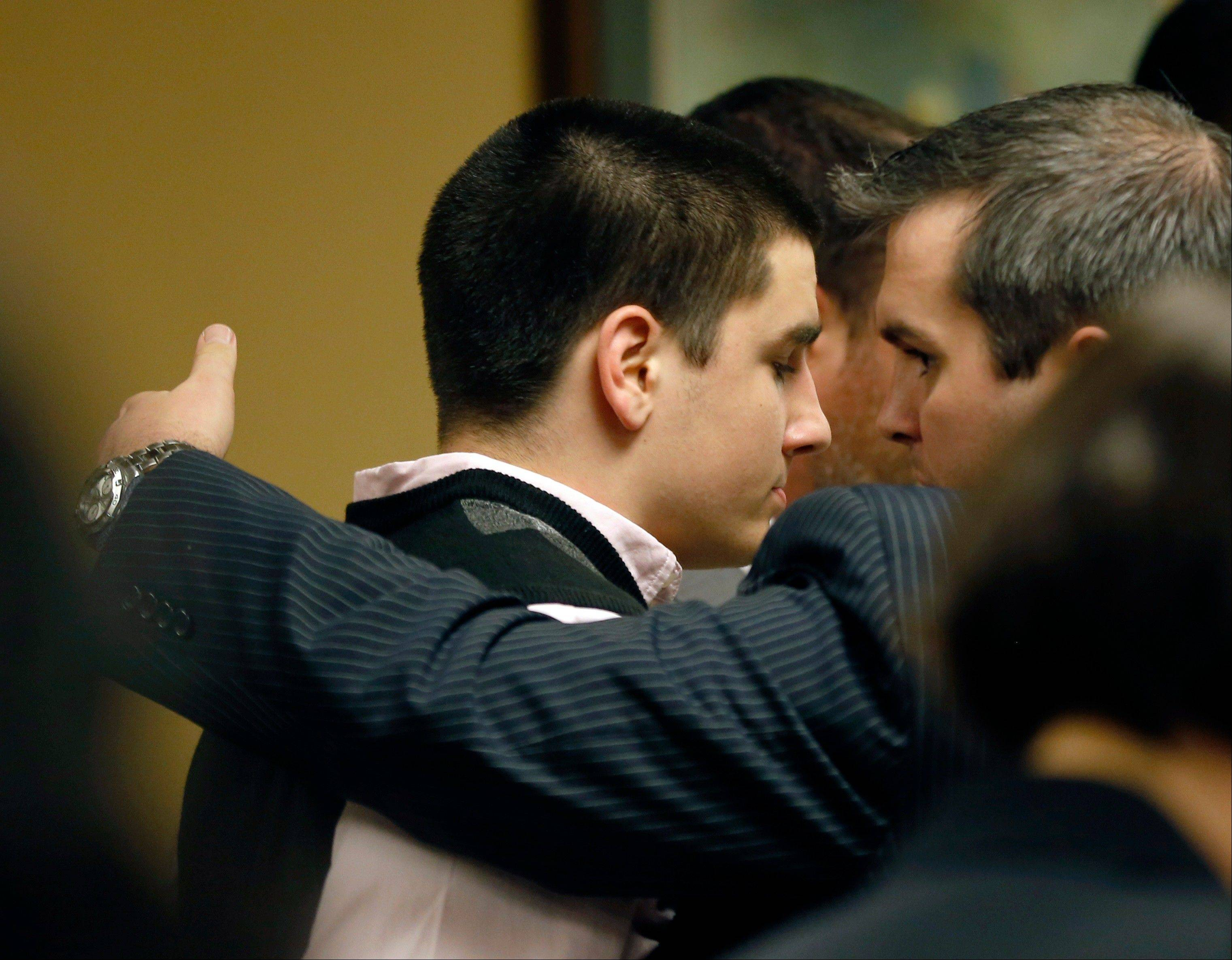 Trent Mays, 17, left, is hugged by one of his lawyers, Brian Duncan, after closing arguments in the juvenile trial for him and co-defendant Ma'lik Richmond, 16, on rape charge.